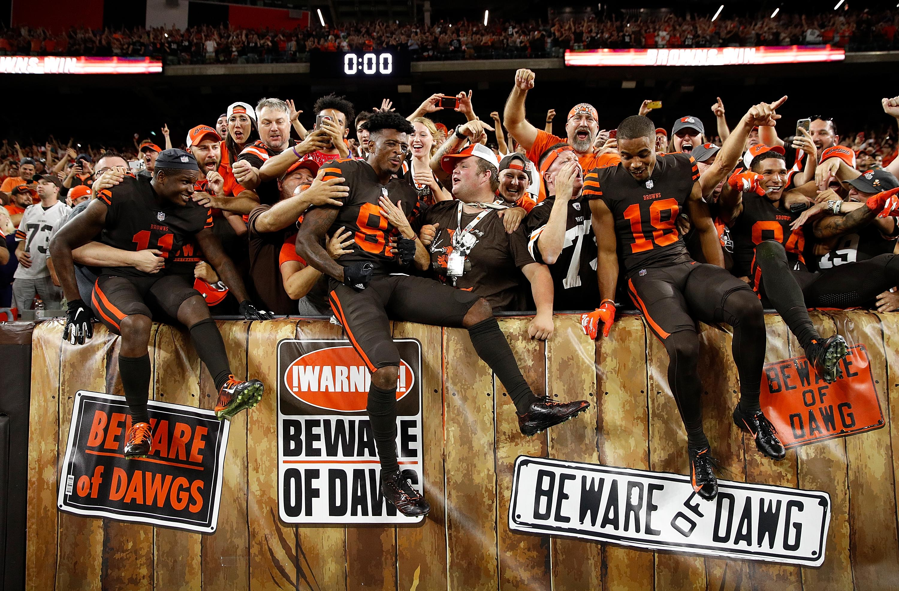 Browns players celebrate in the stands after their victory over the Jets