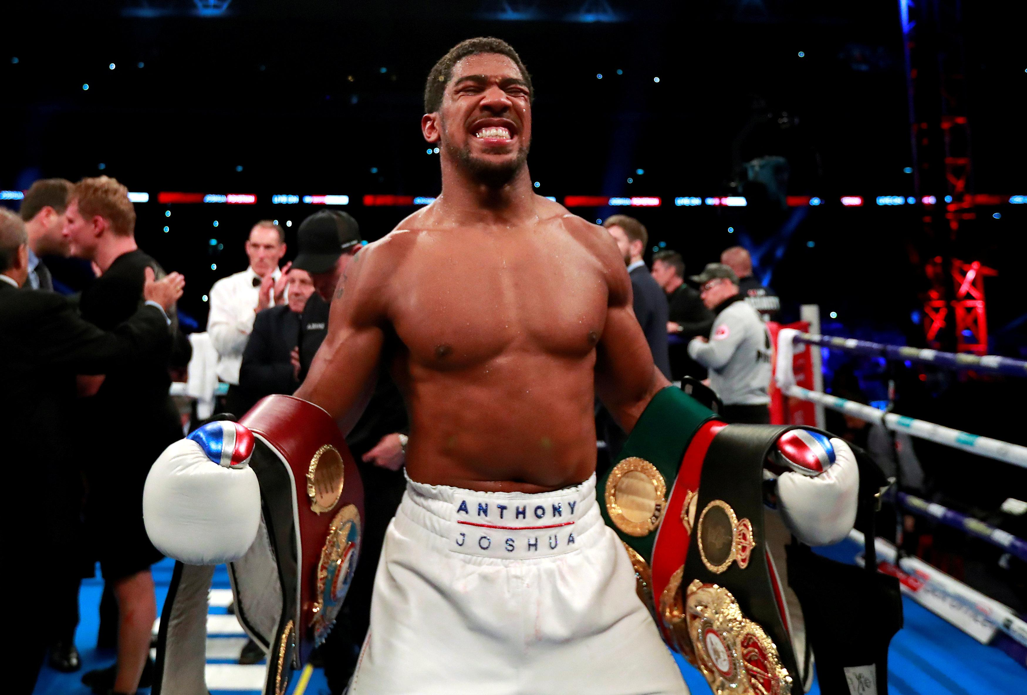 Anthony Joshua roared back from an early scare to win at Wembley