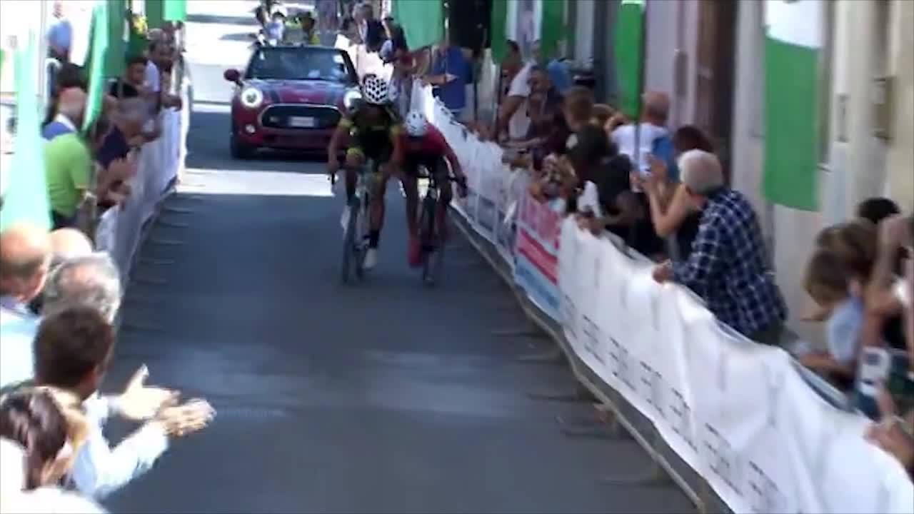 The two cyclists rush for the finish line during a race in Italy