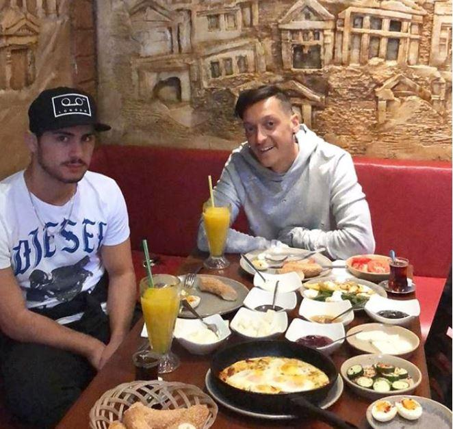 Mesut Ozil, right, and a friend visited Turkish restaurant Likya on Sunday