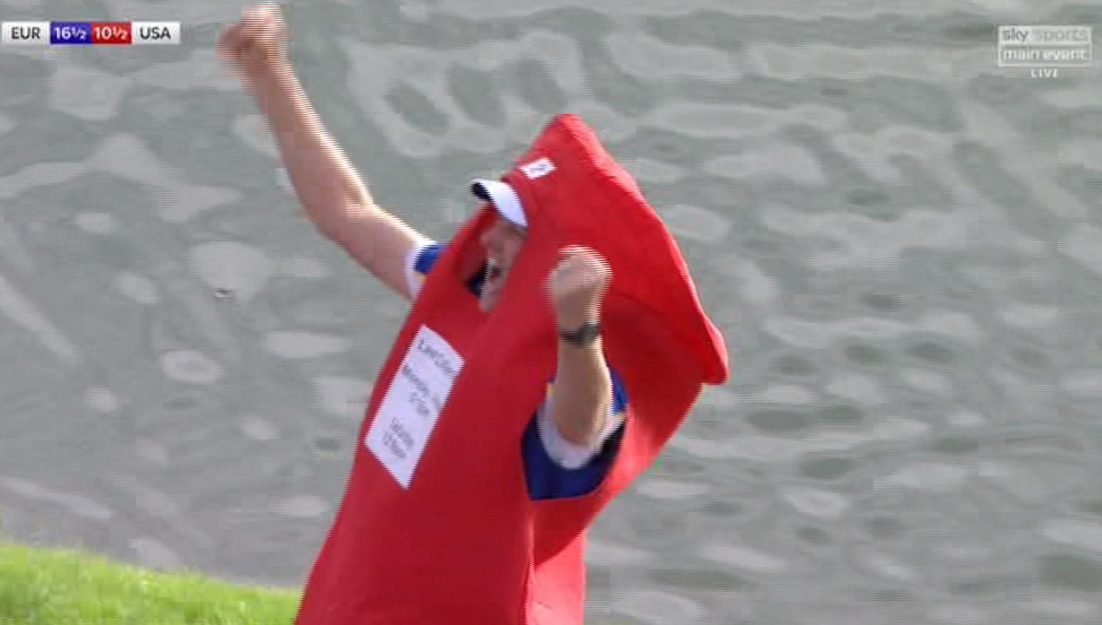Poulter celebrates winning the Ryder Cup while wearing a post box outfit