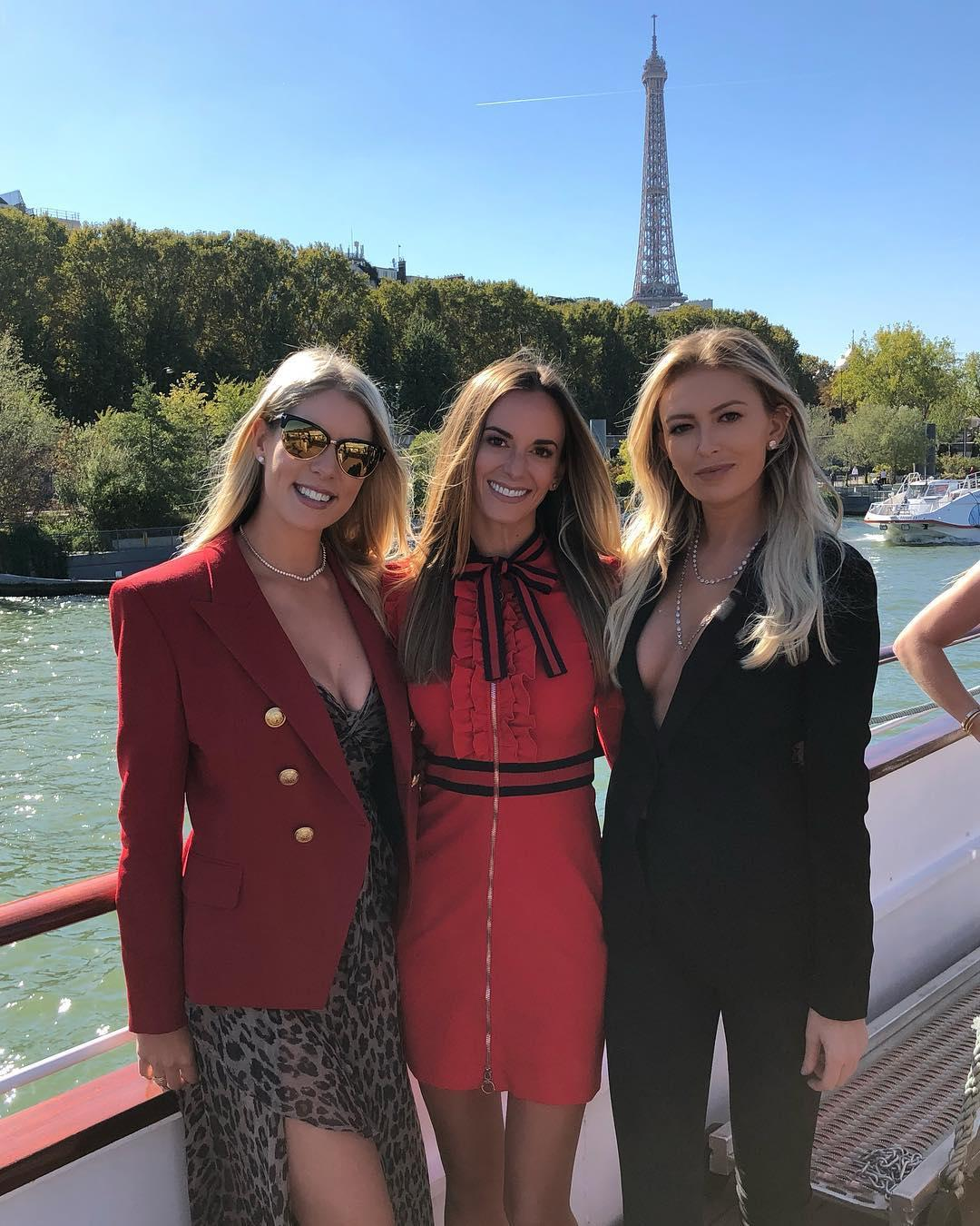 Kelley Cahill, left, Jena Sims, centre, and Paulina Gretzky take in the sights on Ryder Cup Ladies Day