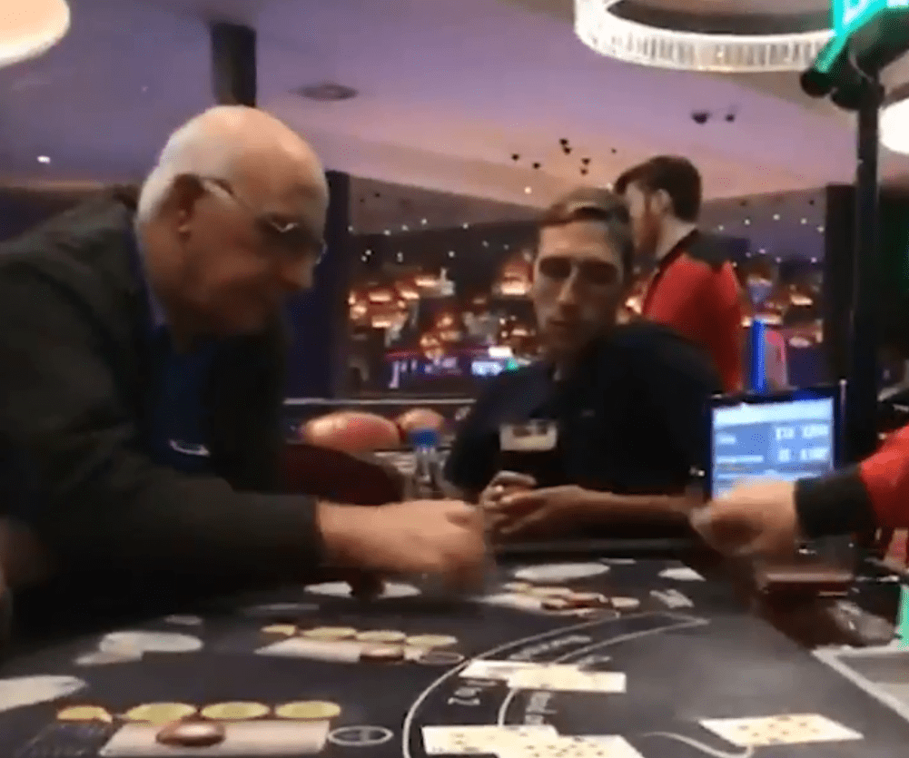 His friends were playing blackjack in the casino