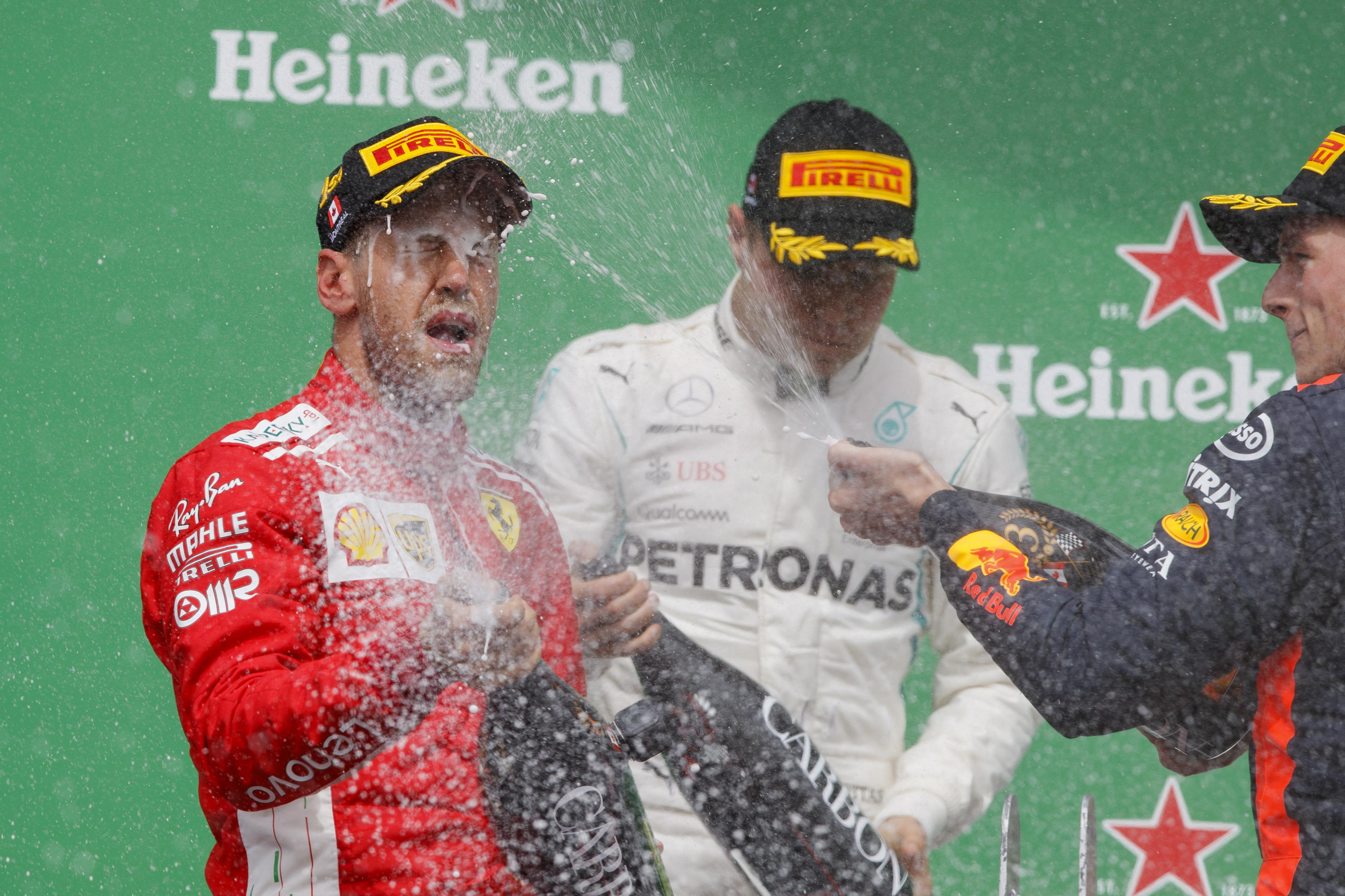 Sebastian Vettel moves one point ahead of Hamilton after winning in Canada