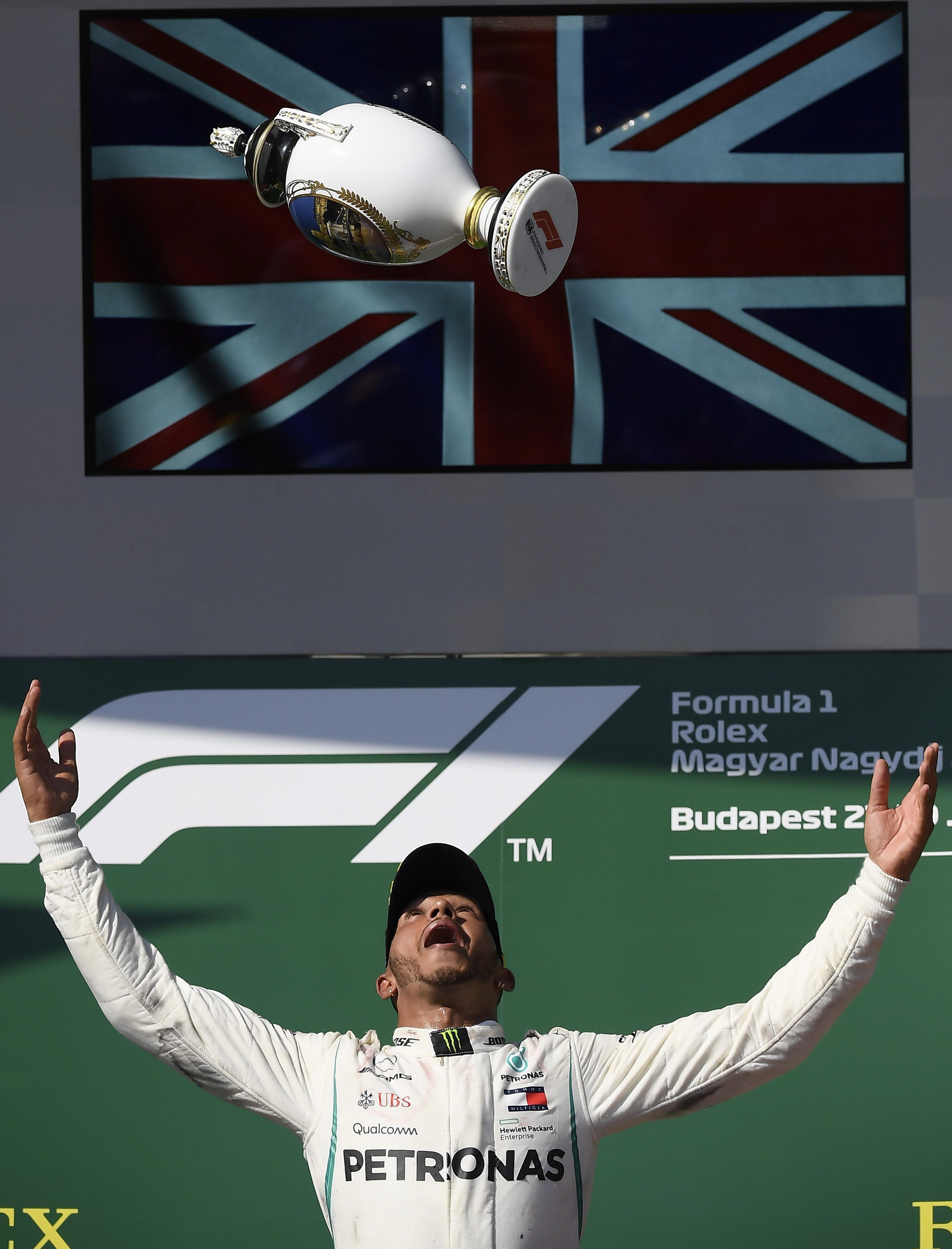 Lewis Hamilton celebrates after picking up a crucial win in Hungary
