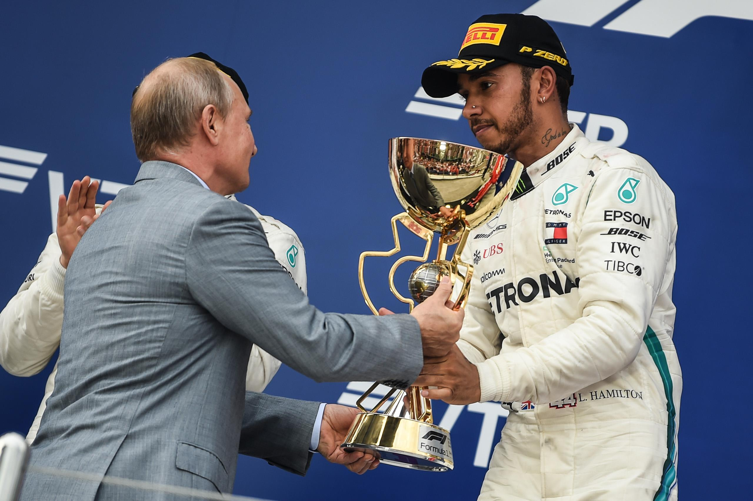 Putin handed Hamilton the trophy for winning the race