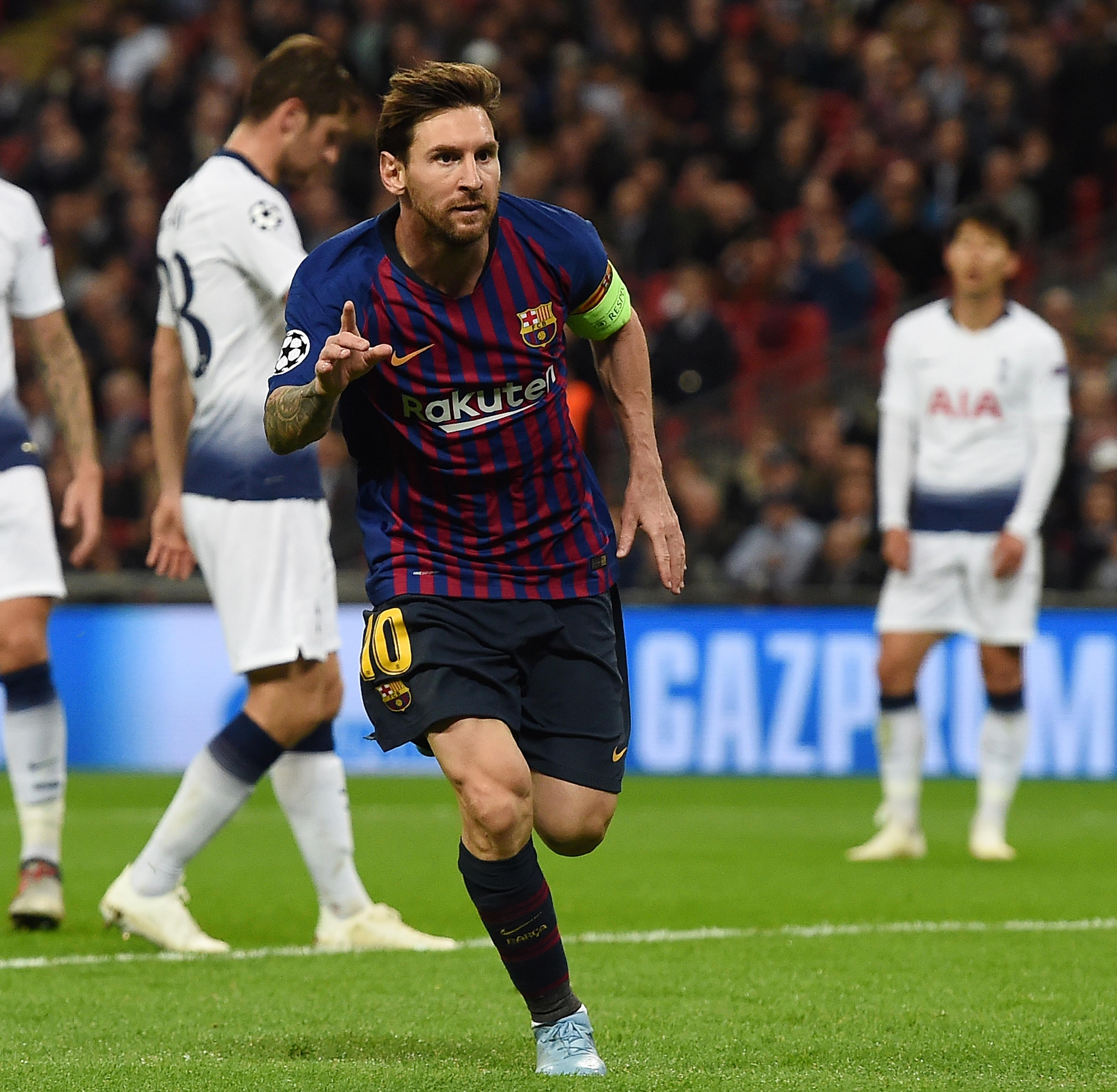 Lionel Messi scored twice to help down Tottenham at Wembley