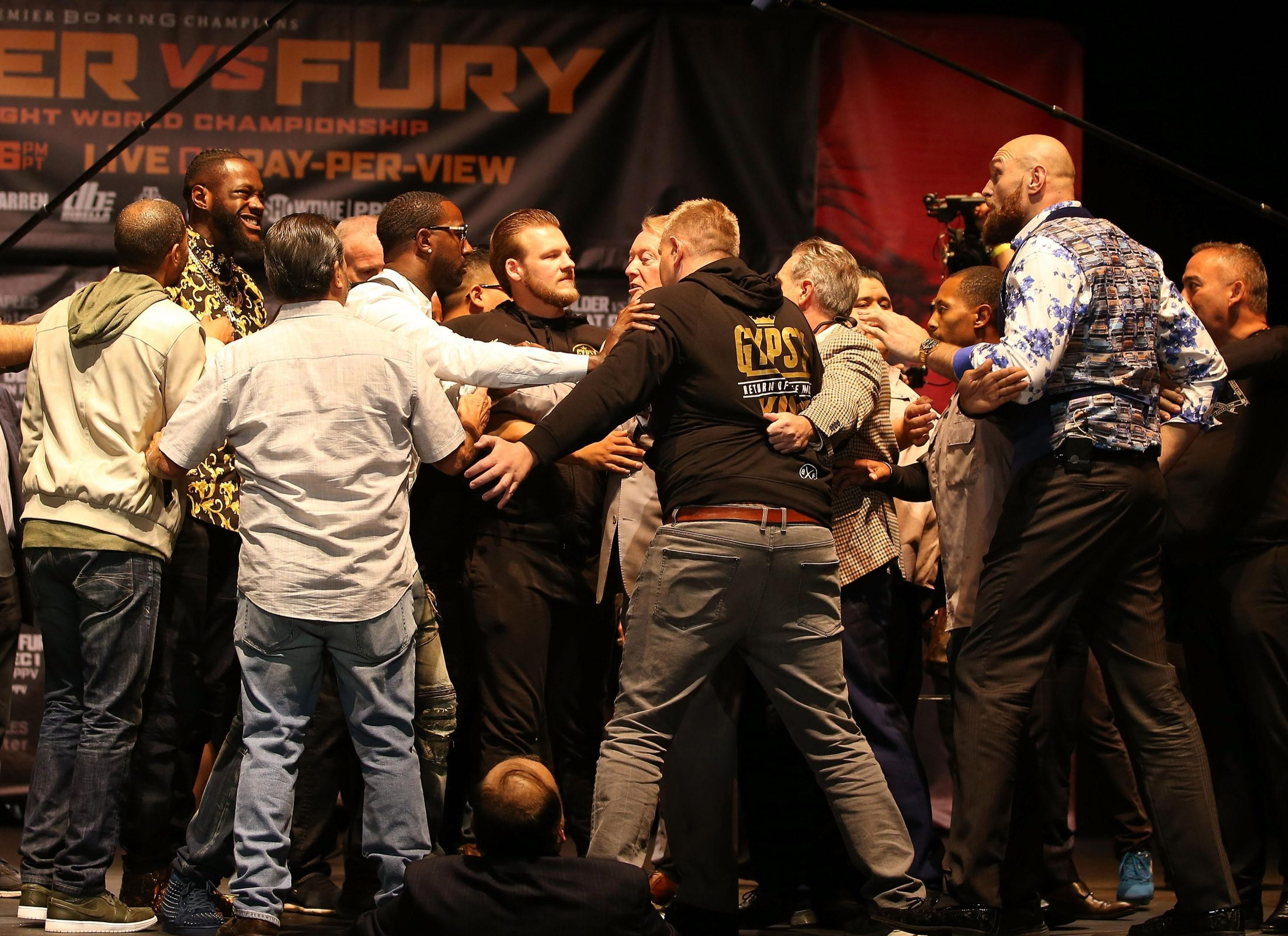 The heavyweights had to be pulled apart on stage at LA's Staples Centre