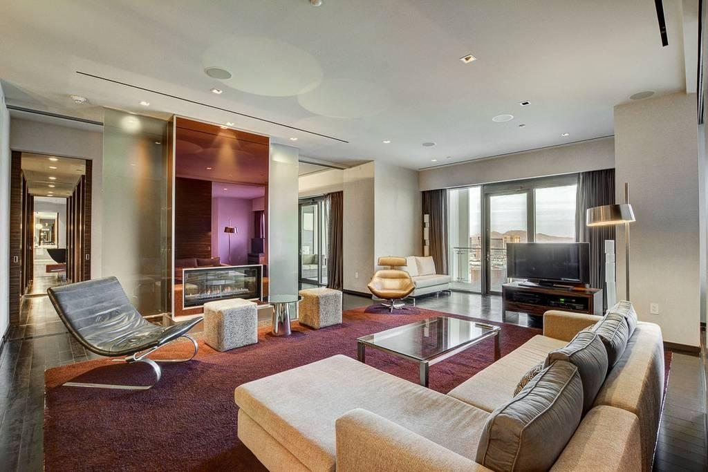The room is adorned with lavish furnishings and has commanding views across Las Vegas