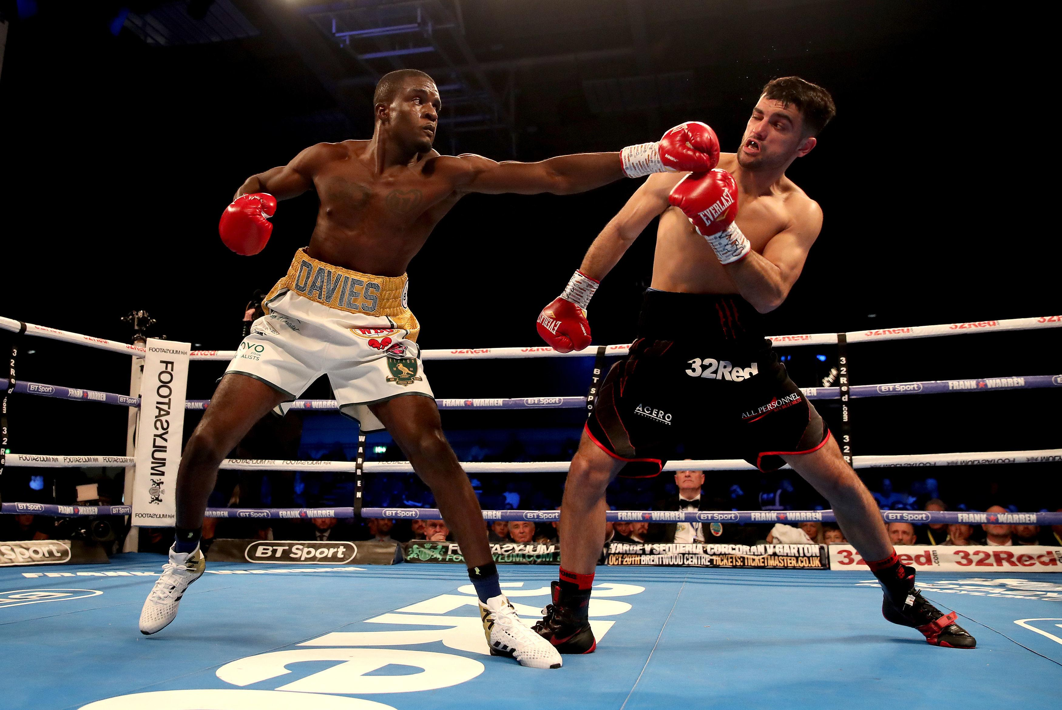 Ohara Davies flings out a left hand at Jack Catterall
