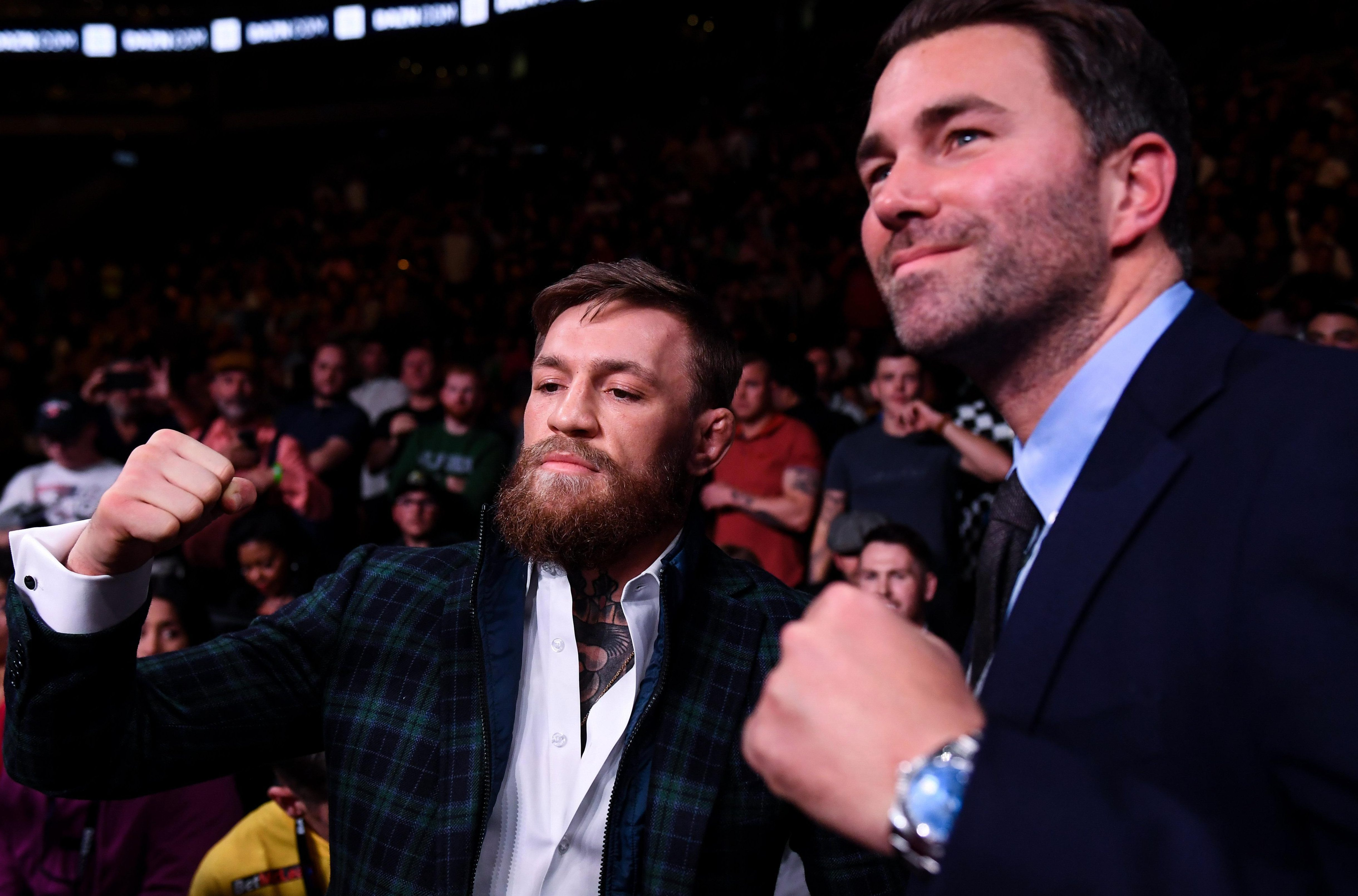 Eddie Hearn, pictured at the weekend alongside UFC legend Conor McGregor, has blasted Deontay Wilder, accusing him of trying to jump on the Joshua bandwagon