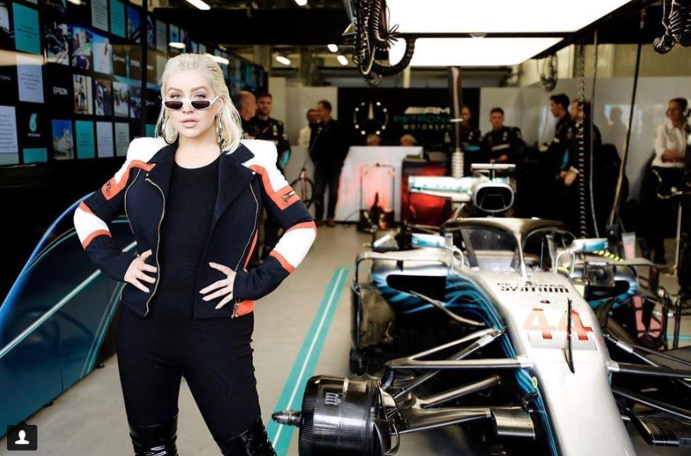 Among the celebrities to join Hamilton on a race weekend is Christina Aguilera
