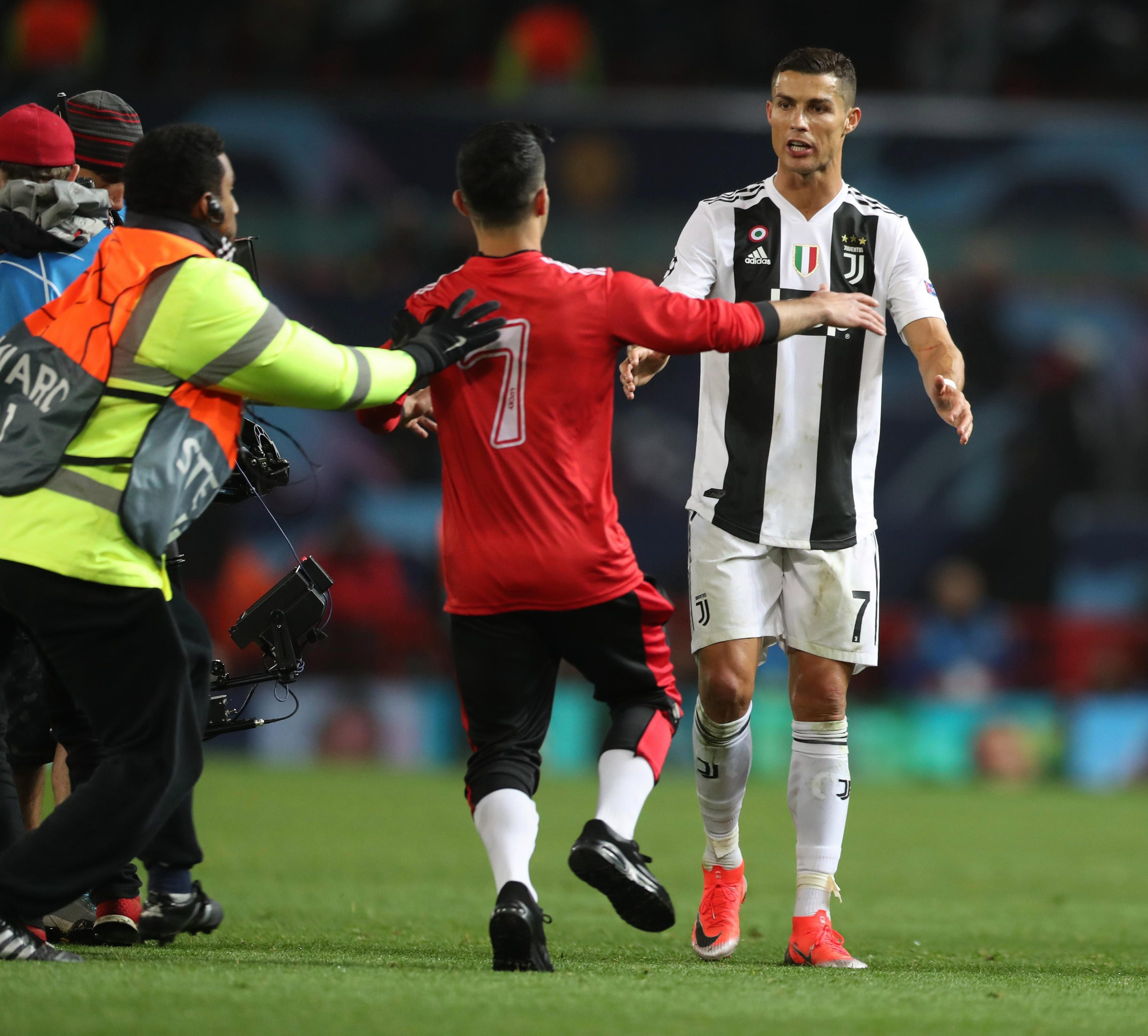 A fan also wanted to get close to the Portuguese football legend - with the stewards caught short
