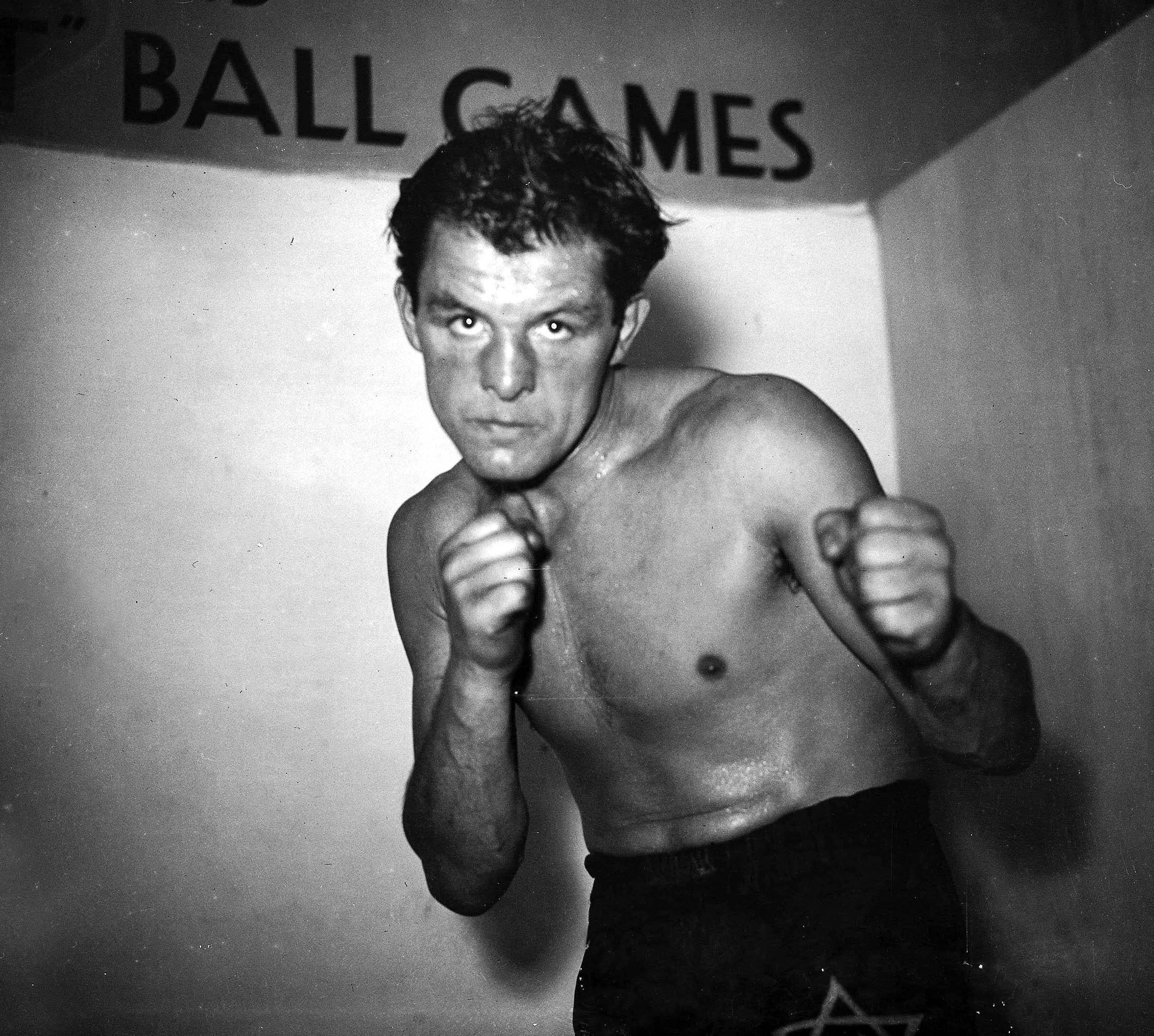 Jack Kid Berg, the former world junior welterweight champion, pictured in Whitechapel, had a childhood akin to a Dickens novel