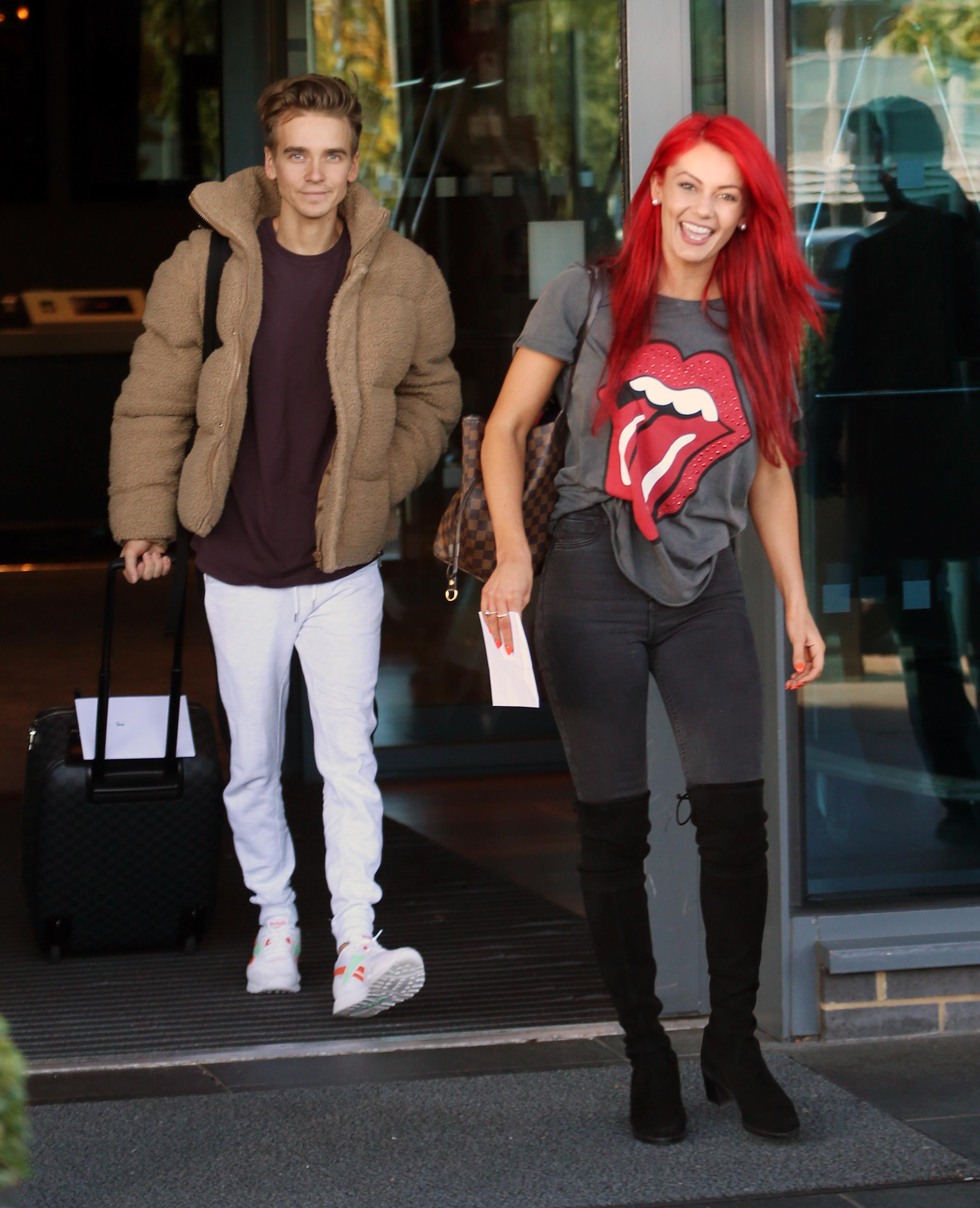 Strictly's Dianne Buswell grins as she's pictured leaving ...