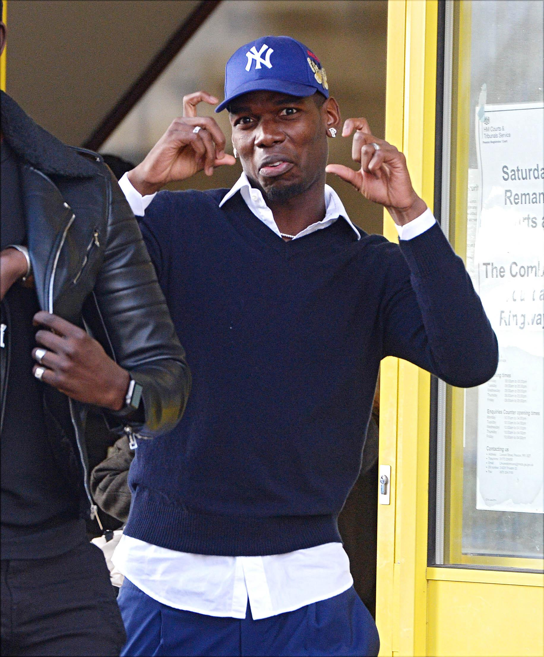 As he left court, Pogba mocked Sun photographer Jim Clarke and mimicked the action of taking a picture