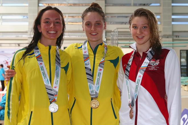 Tazmin, right, smiles next to two other medallists at the Commonwealth Youth Games in Apia, Samoa, in 2015
