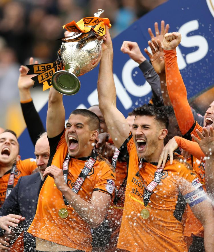 Conor Coady and Danny Batth lifted the trophy together at the end of last season