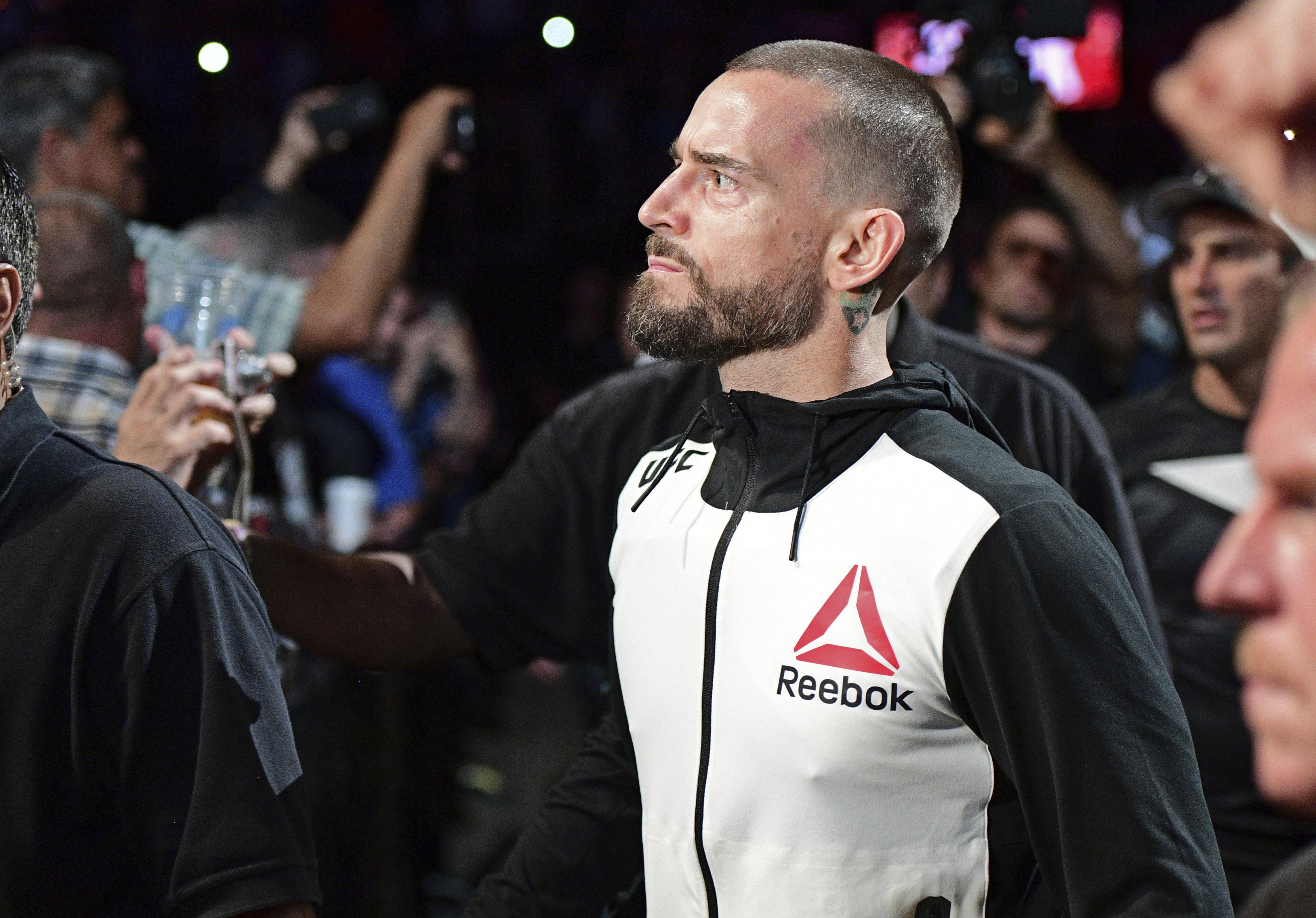 CM Punk is set to get behind the microphone for the Cage Fury Fighting Championships on December 14