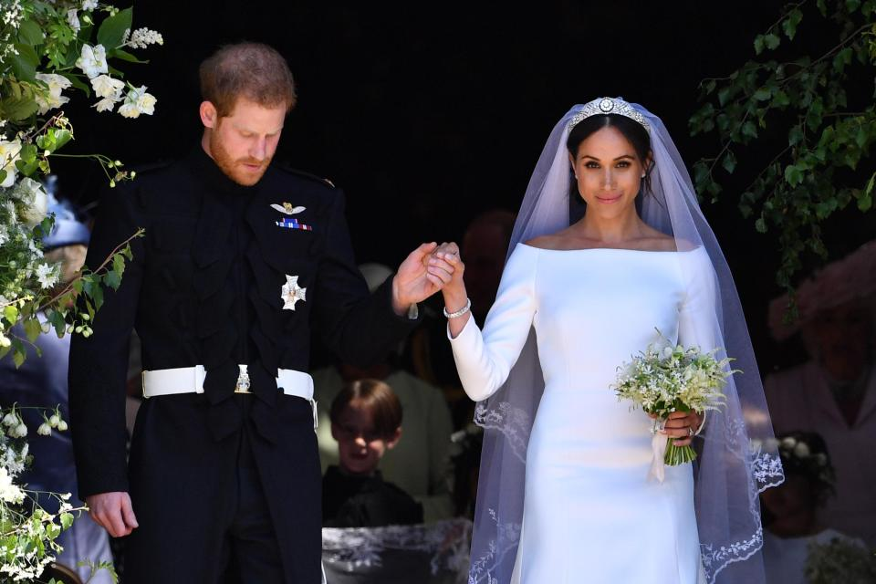 Prince Harry and Meghan Markle emerge from St George's Chapel after their wedding ceremony