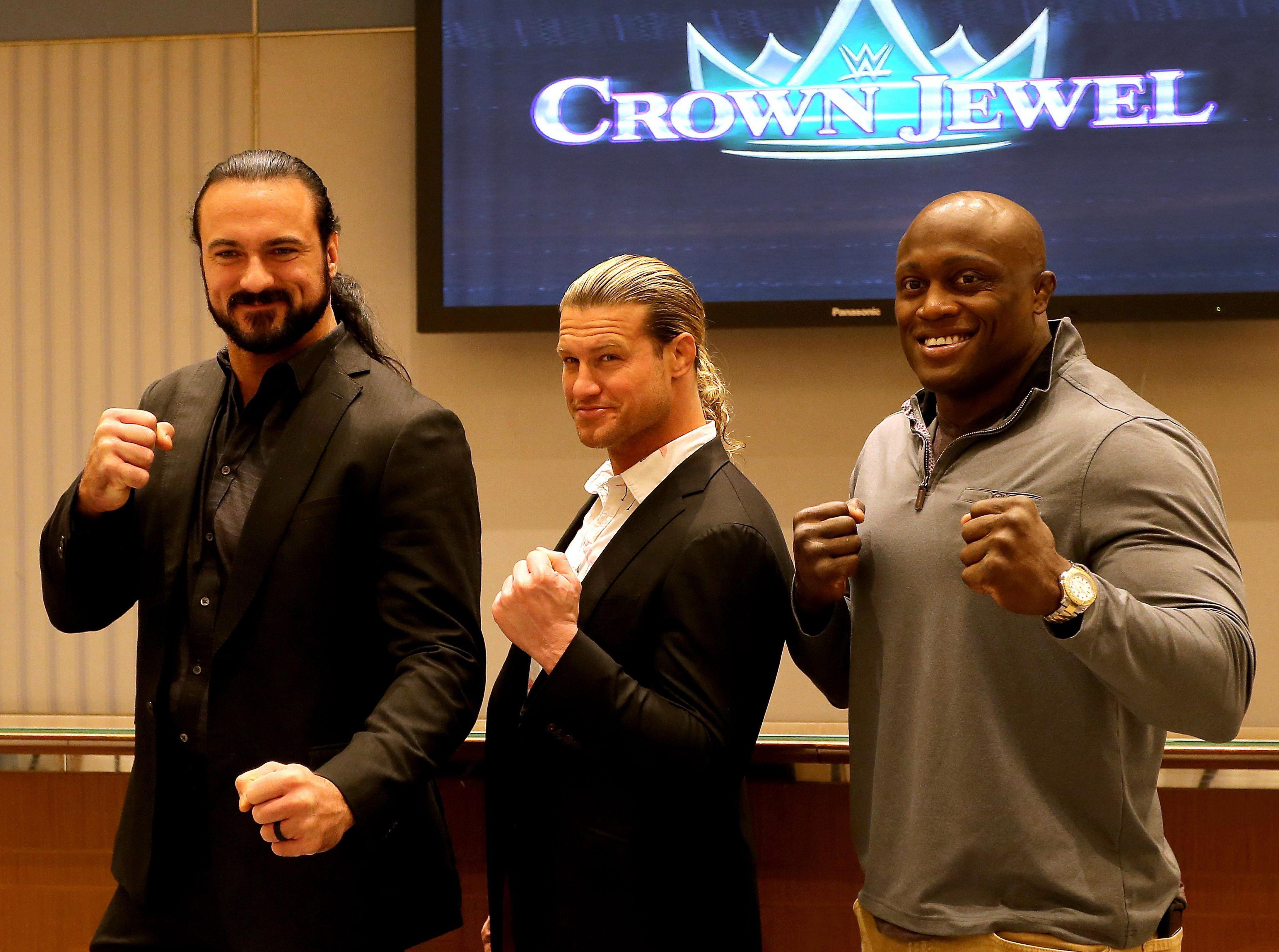 Wrestlers Drew McIntyre, Dolph Ziggler and Bobby Lashley face the camera