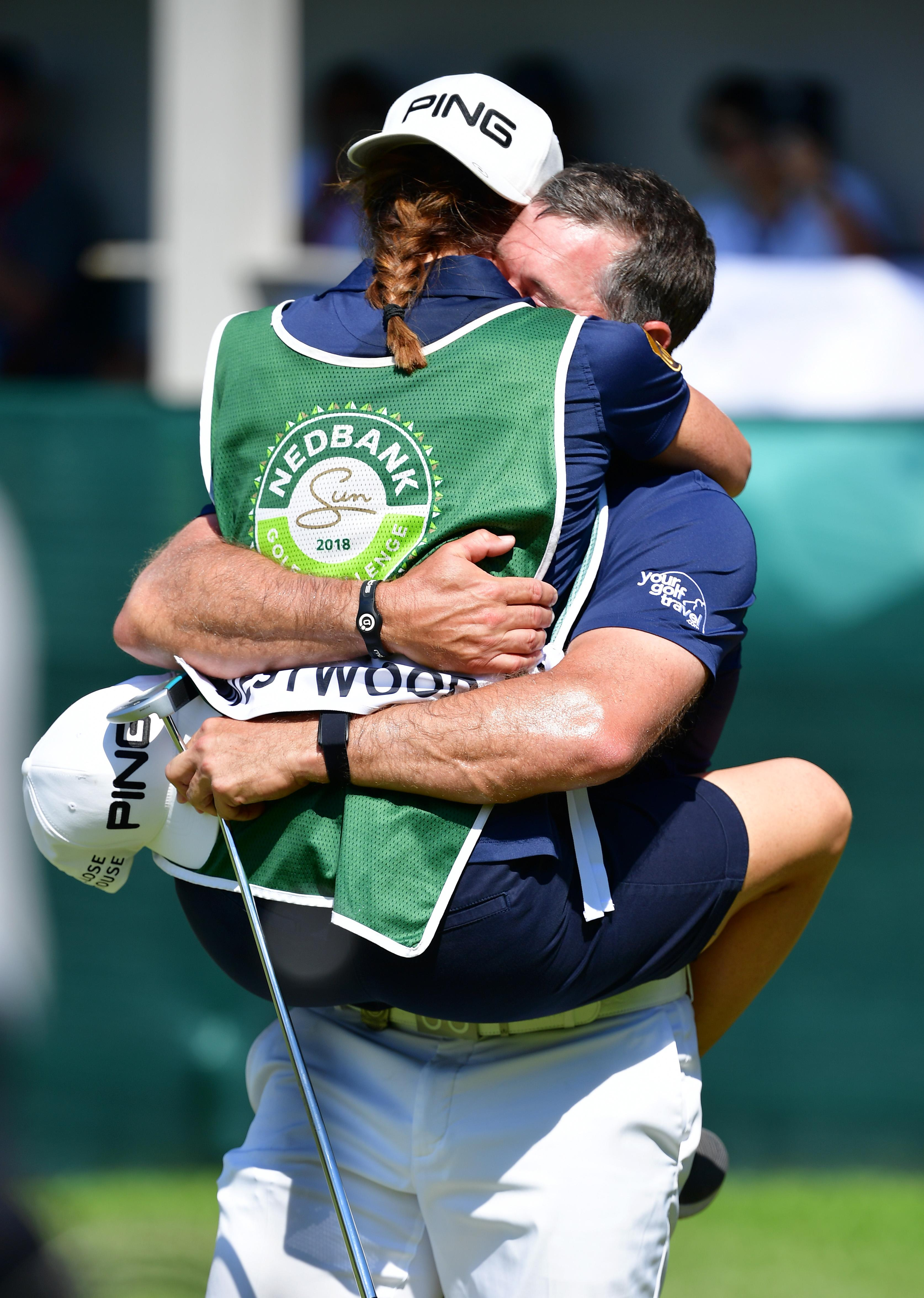 Lee Westwood celebrated his win today as girlfriend Helen Storey jumped on him