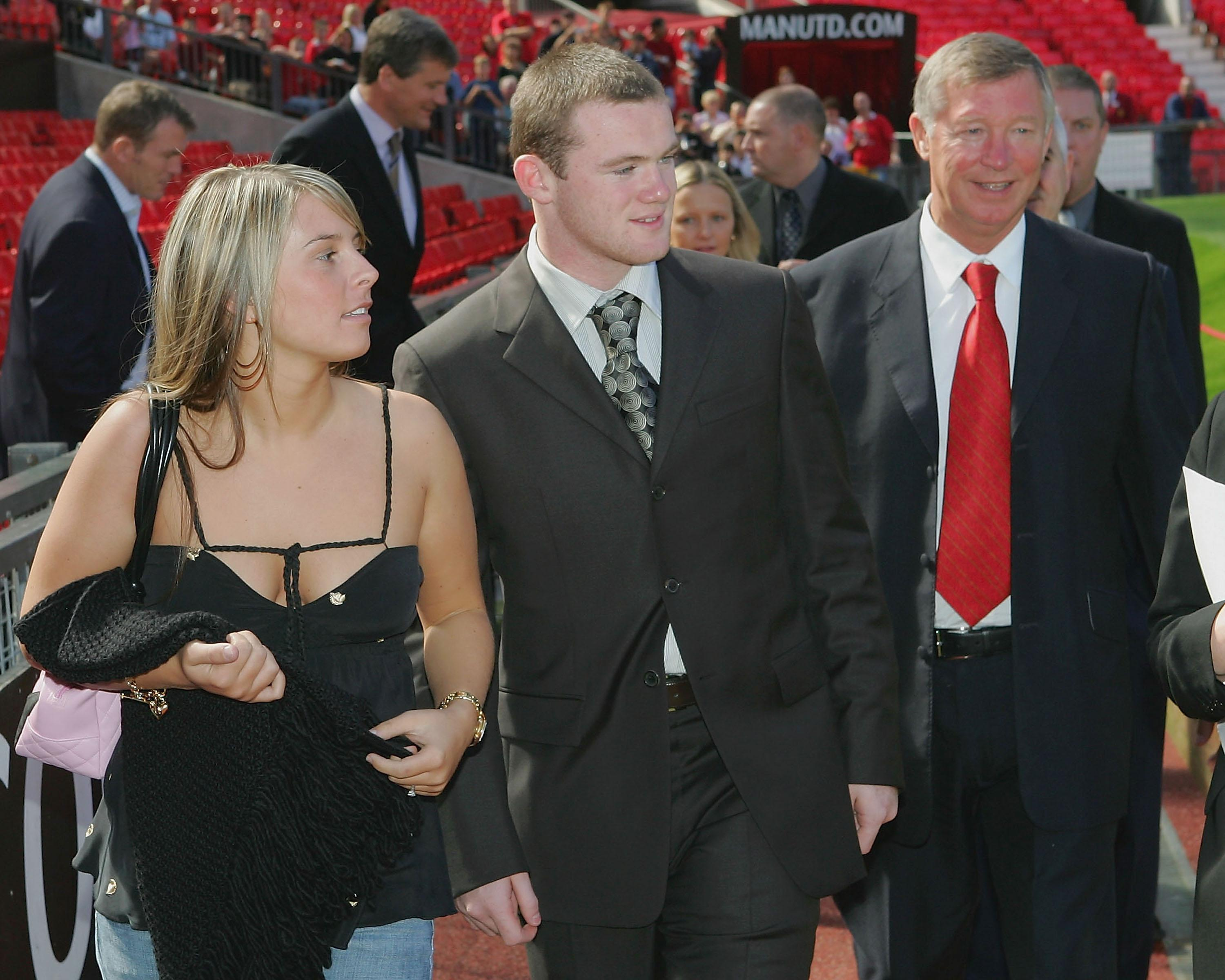 Coleen was alongside Roo when he signed for Manchester United