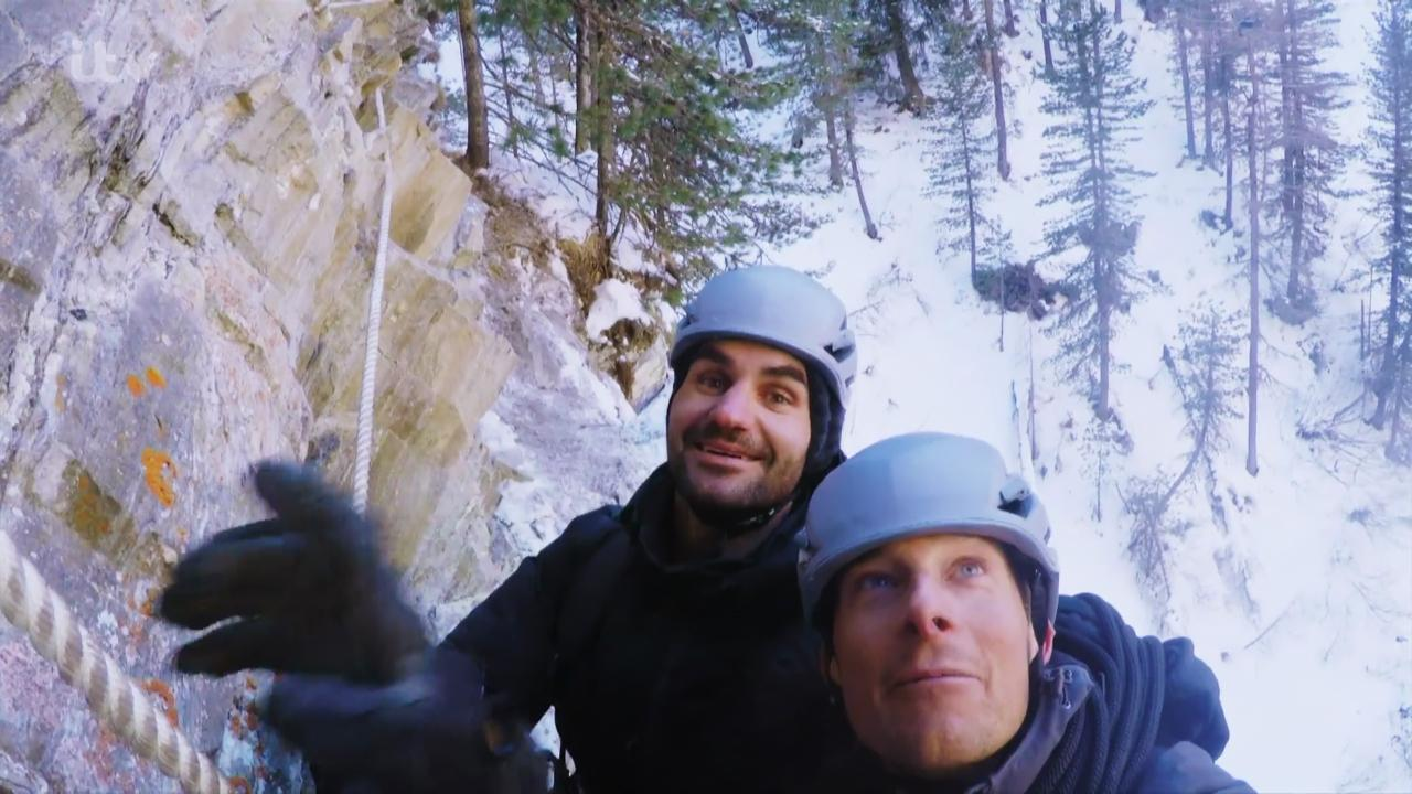 Federer pictured abseiling with survival expert Bear Grylls