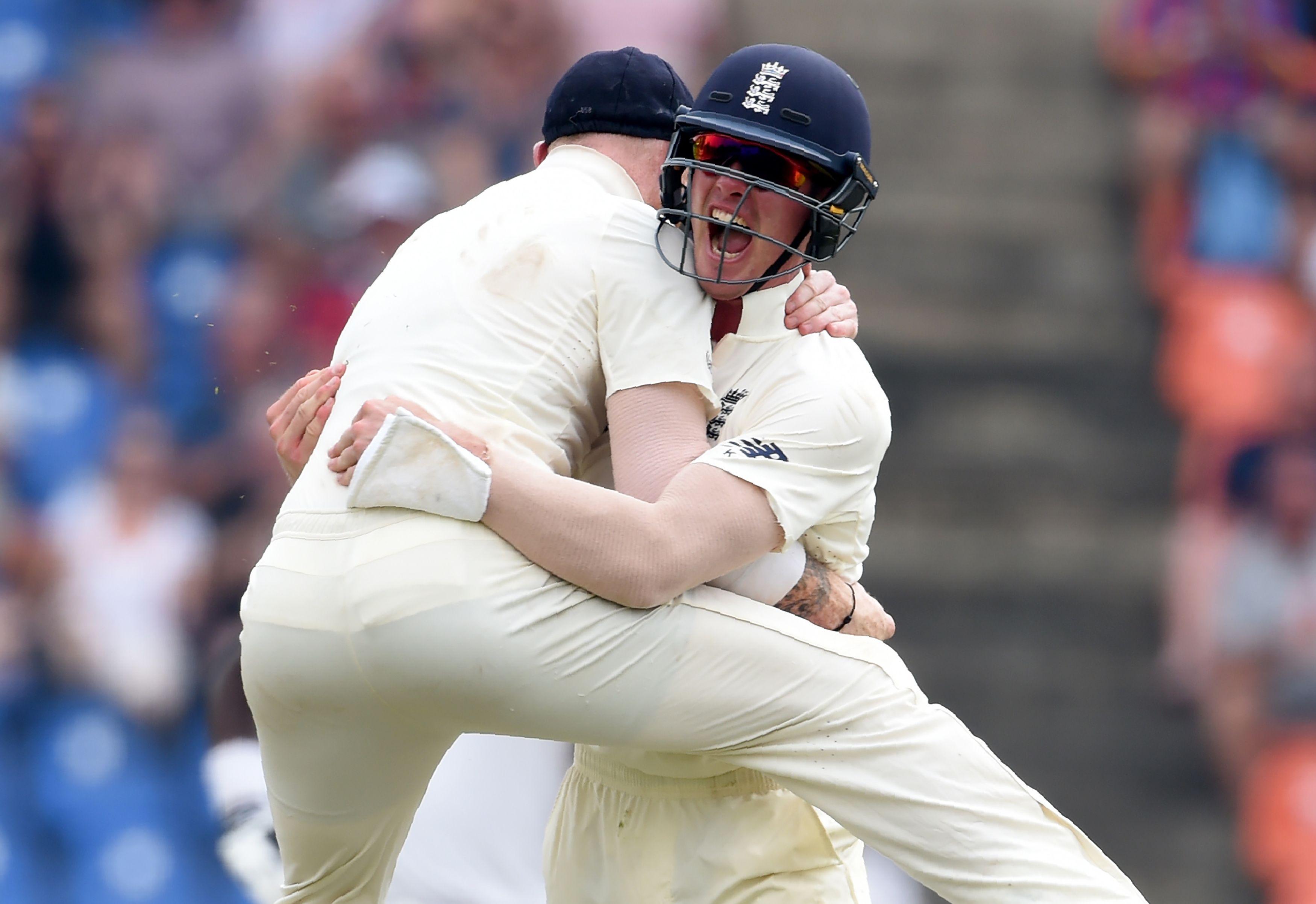 Keaton Jennings, right, celebrates with Ben Stokes after dismissing Sri Lanka's Dimuth Karunaratne
