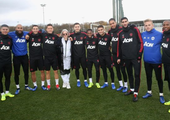 Paul Woolston, second right, and singer Anne-Marie are the additions to this United training photo, minus several stars still away after international duty