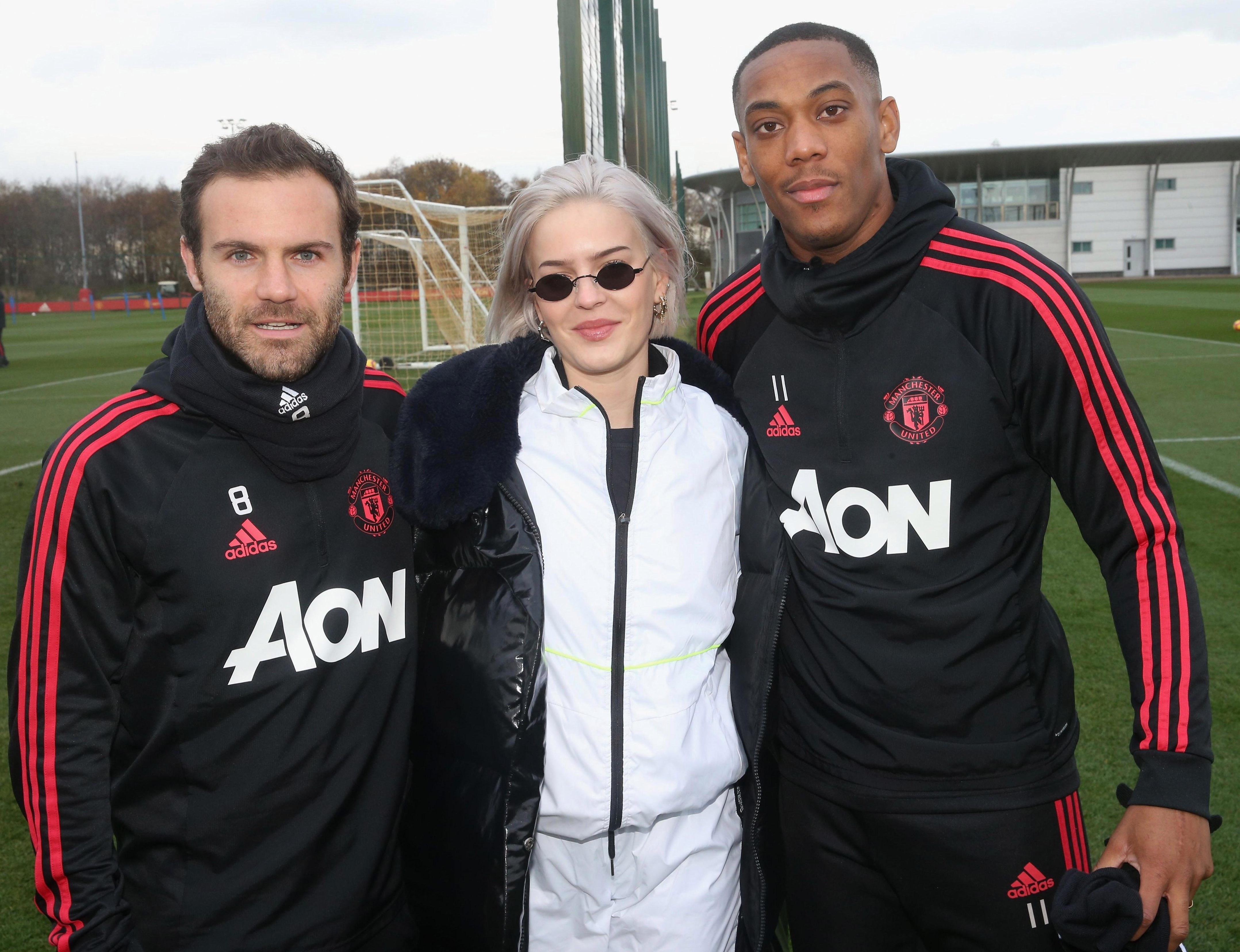 Singer Anne-Marie joins Spain midfielder Juan Mata and France striker Anthony Martial at Carrington - after both missed out on international duty