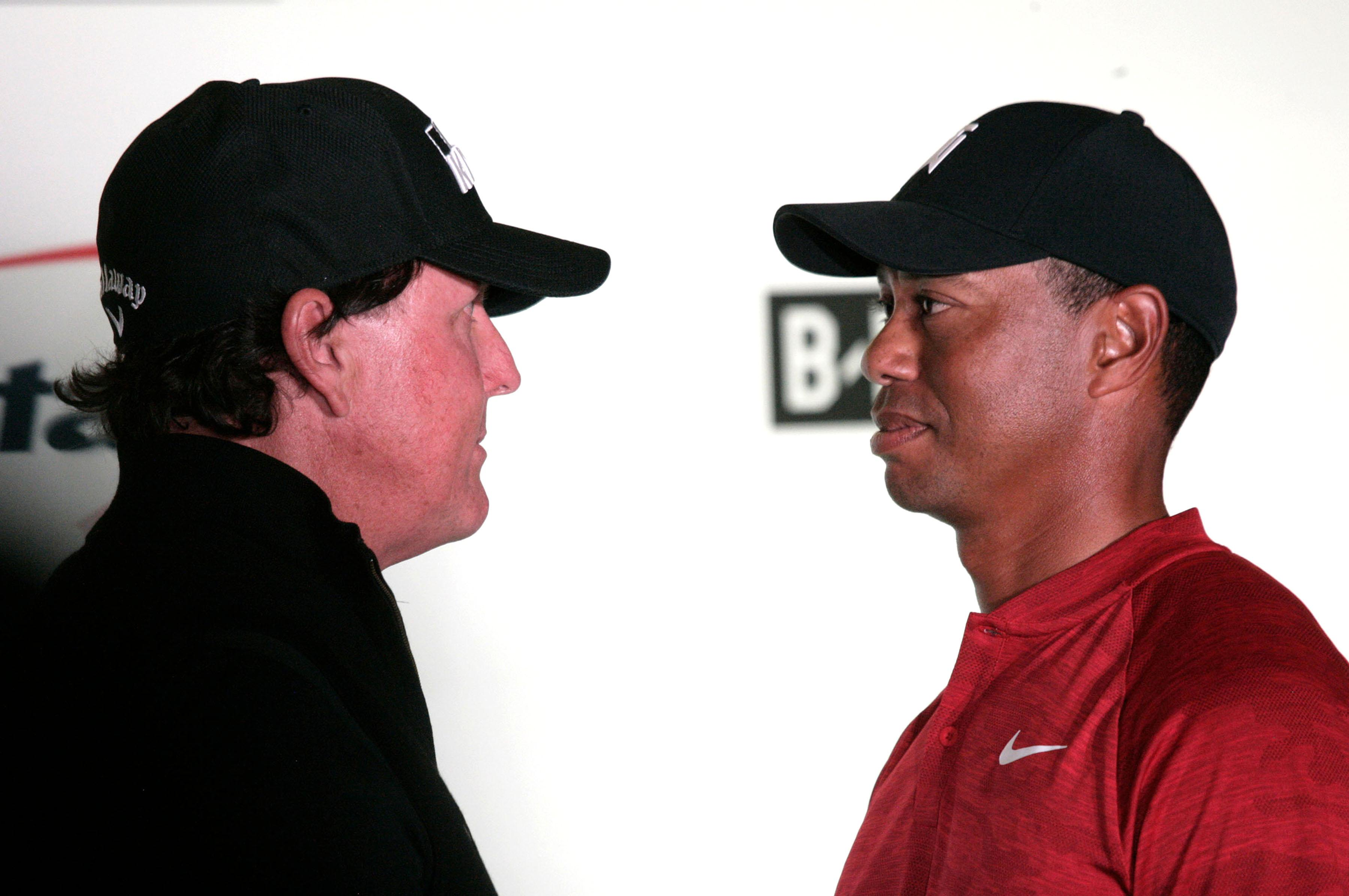 Phil Mickelson, left, and Tiger Woods have gone head-to-head in 'The Match'