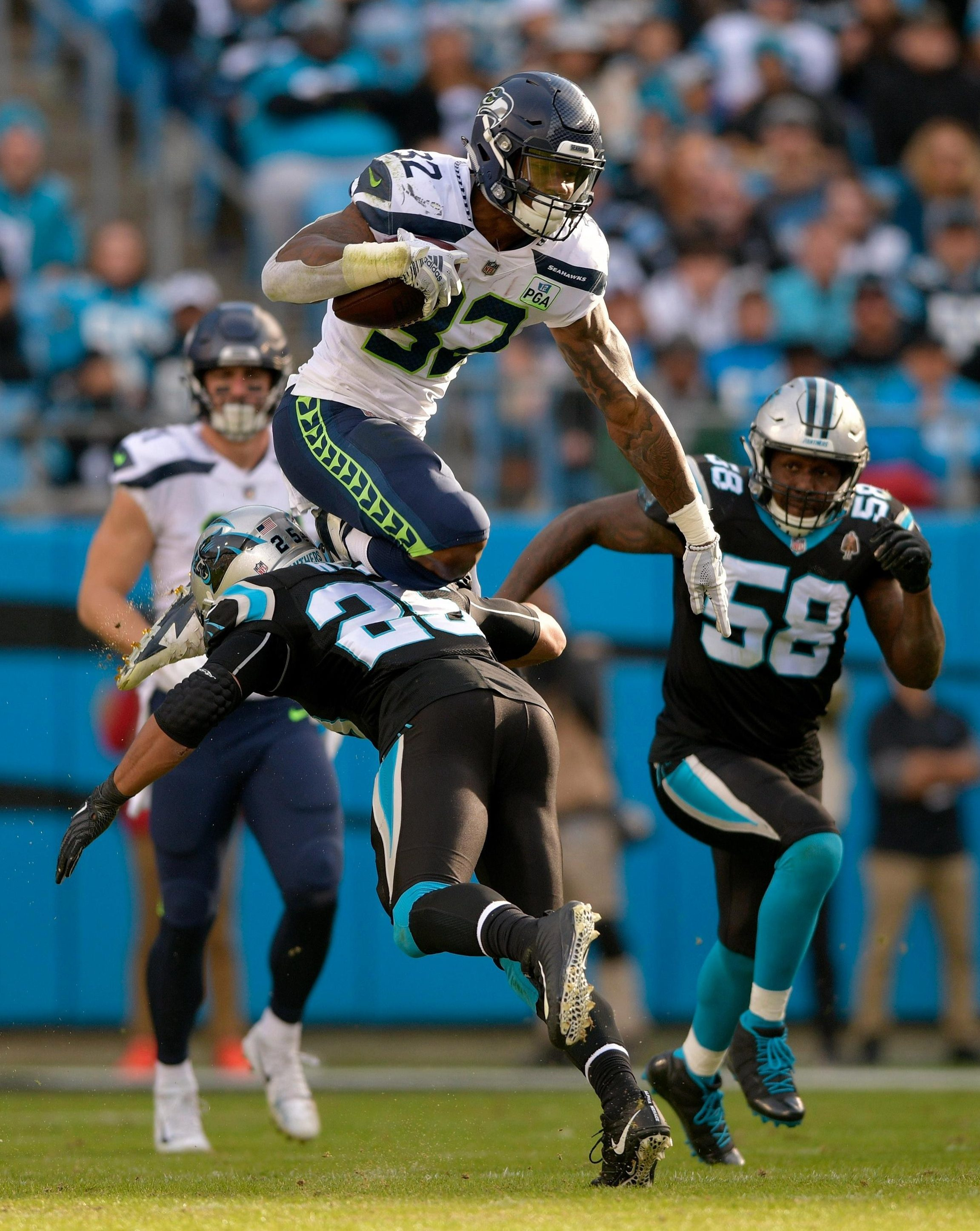NFL star Chris Carson pulled off an incredible somersault - but got a telling off from his mother