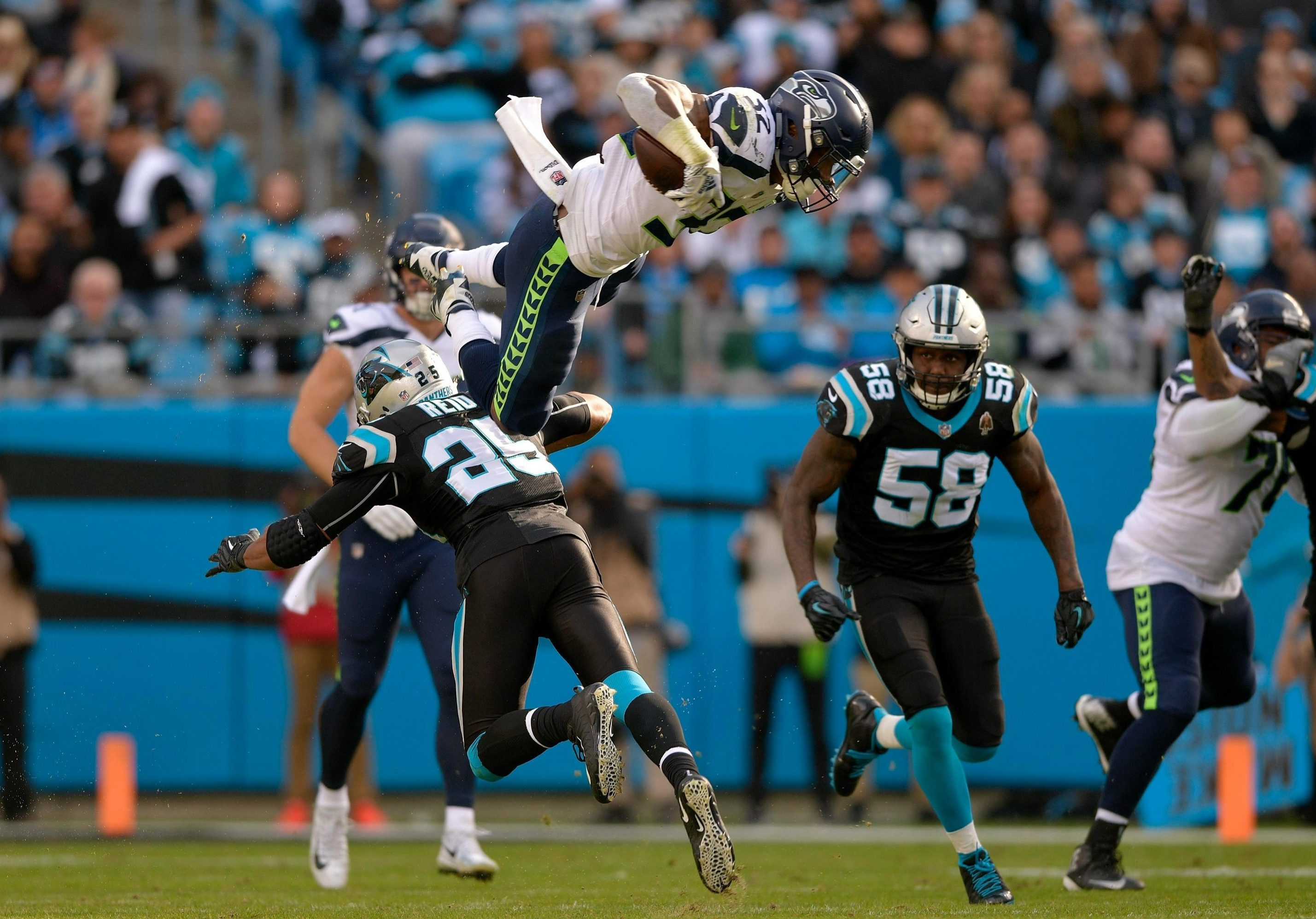 Carson attempted to hurdle Eric Reid but caught his ankle and was sent spinning into the air