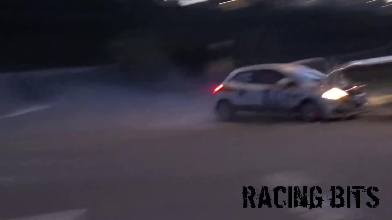 The person was caught on camera skidding off the road and towards a group of spectators