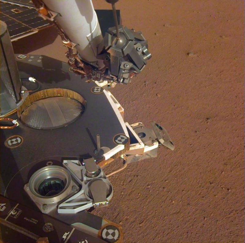 InSight's specialised robotic arm will be used to move scientific instruments from the craft to the surface