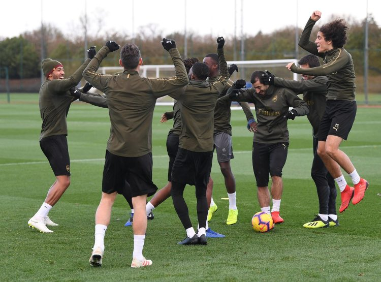 The Arsenal squad joke around in training on Friday but Dave Kitson says they will be feeling sick to the stomach