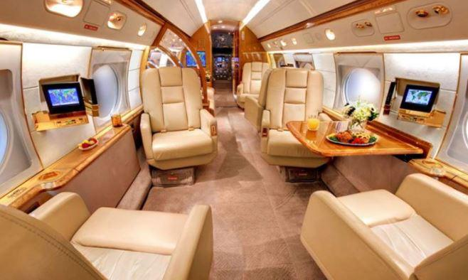 Private jet has kitchen and two bathrooms