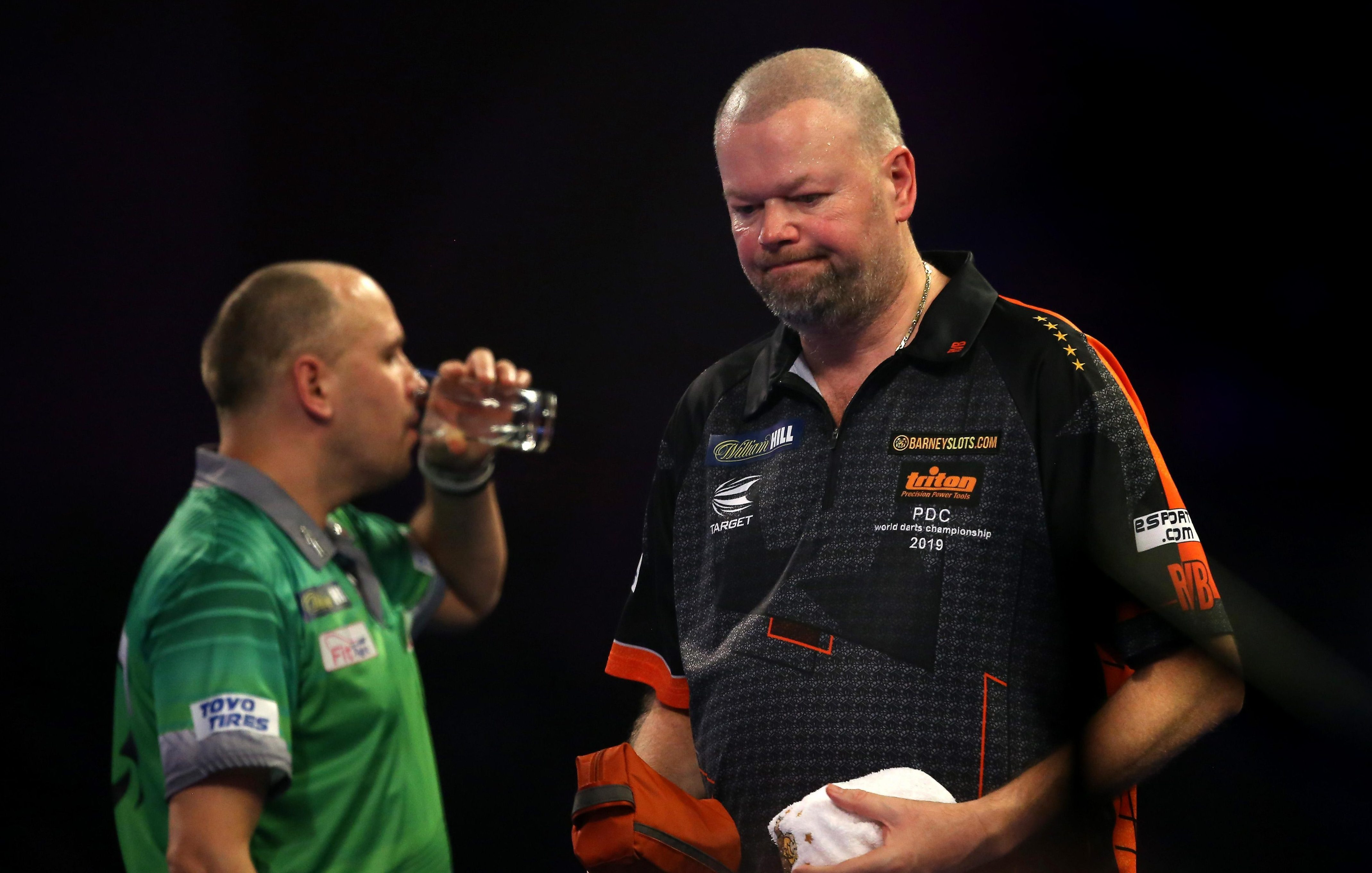 Raymond van Barneveld was knocked out of the World Darts Championship on Monday night