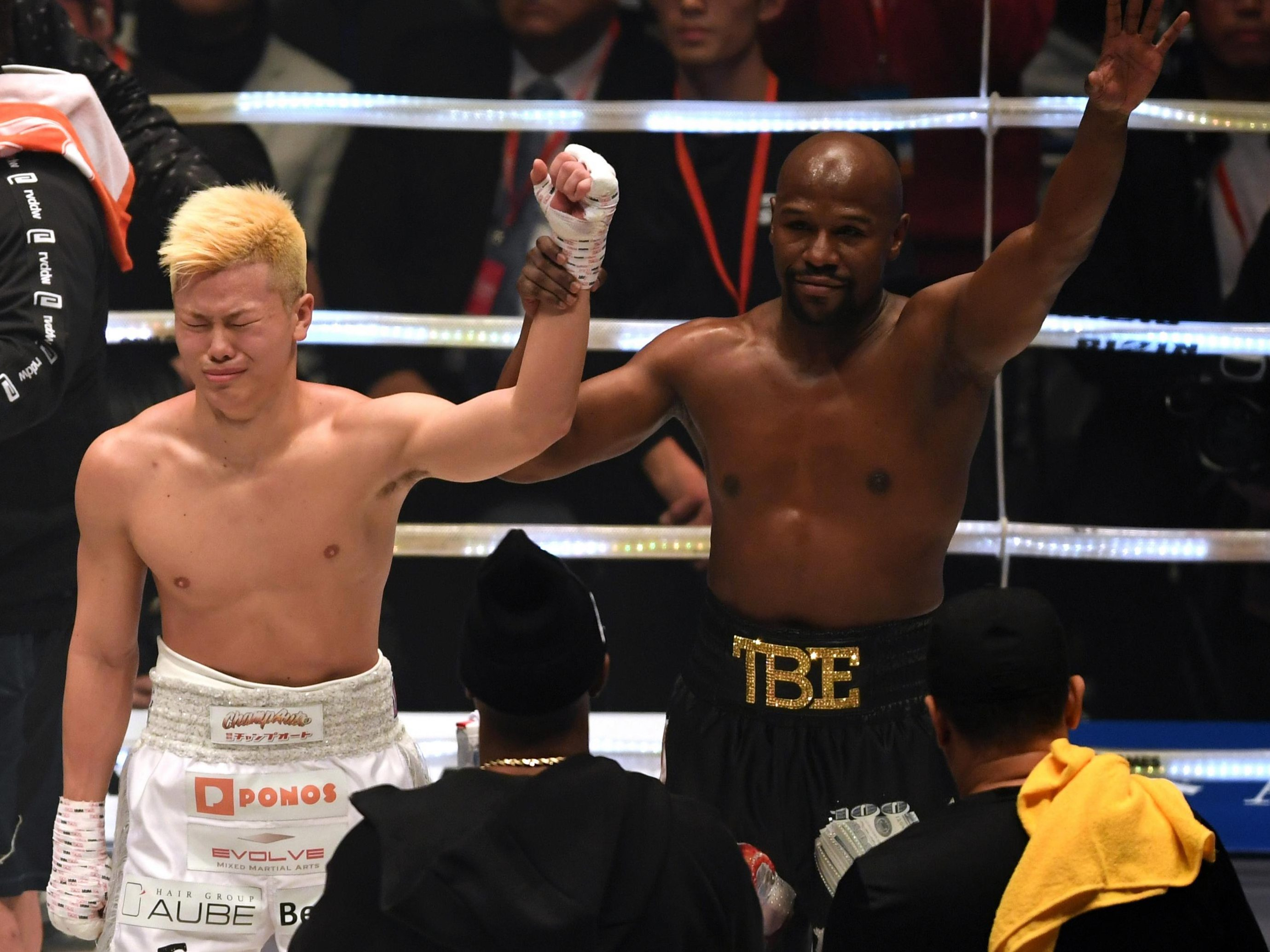 Floyd Mayweather raised the hand of the man he had completely outclassed in the boxing ring