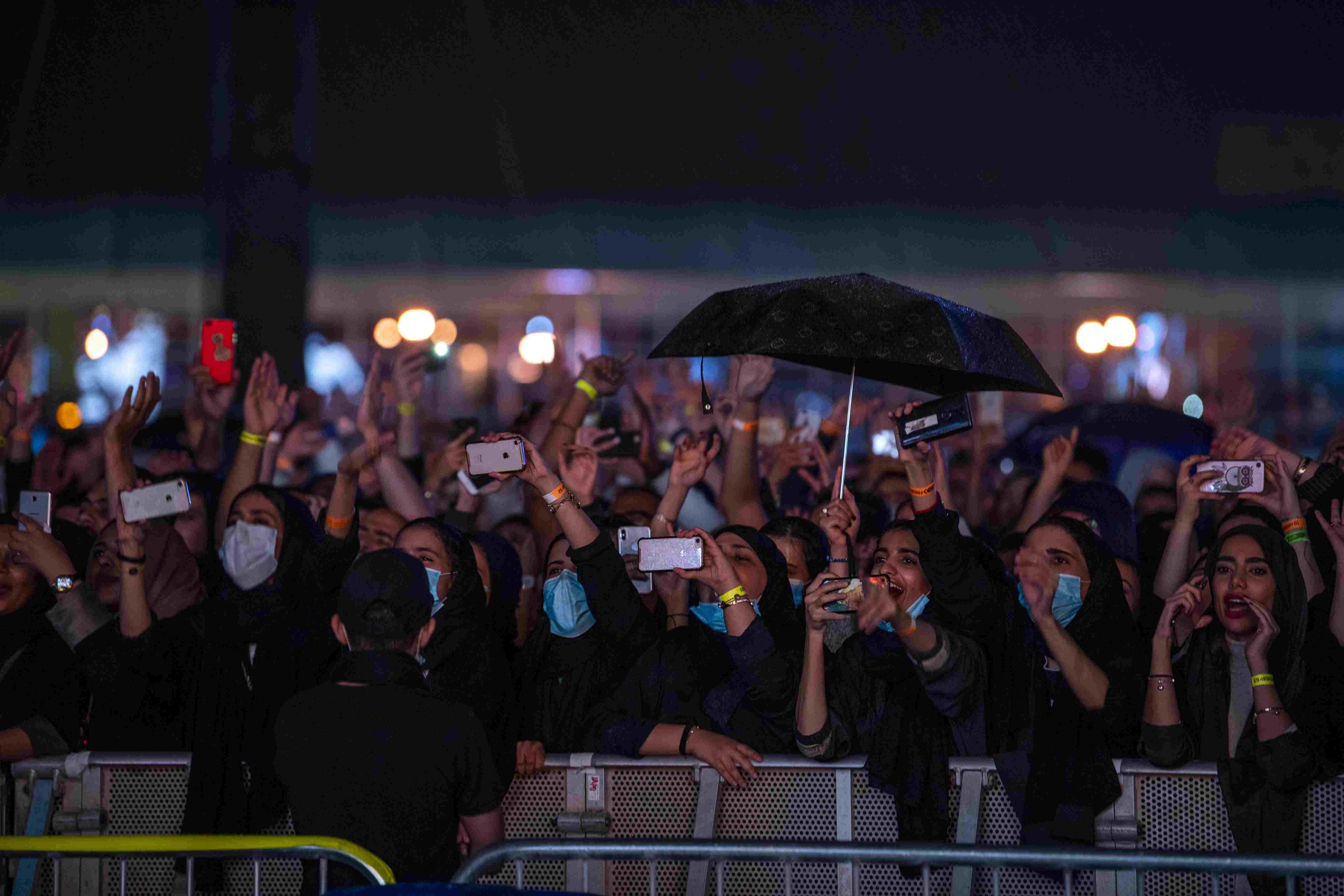 Fans rushed to the front of the stage despite the rain