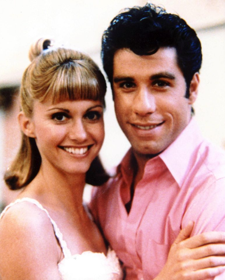 John Travolta - with hair- and co star Olivia Newton John in the real Grease