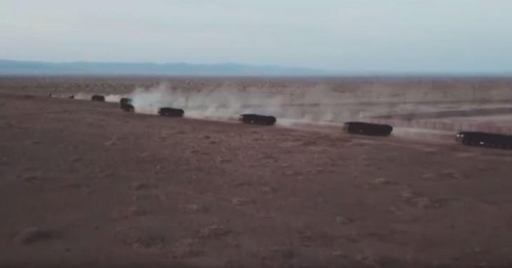 Video on state television showed rocket launcher vehicles taking up position in the desert