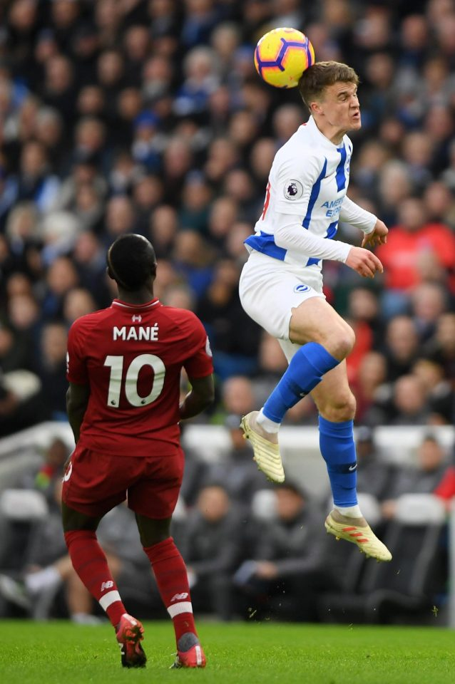 Solly March gets a flick on ahead of Sadio Mane