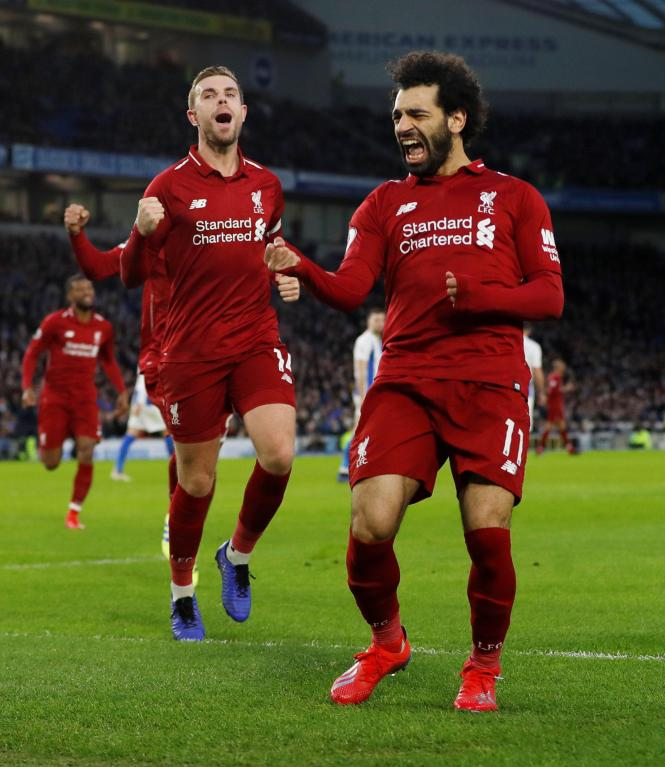 Salah celebrates after scoring the penalty which set Liverpool on their way