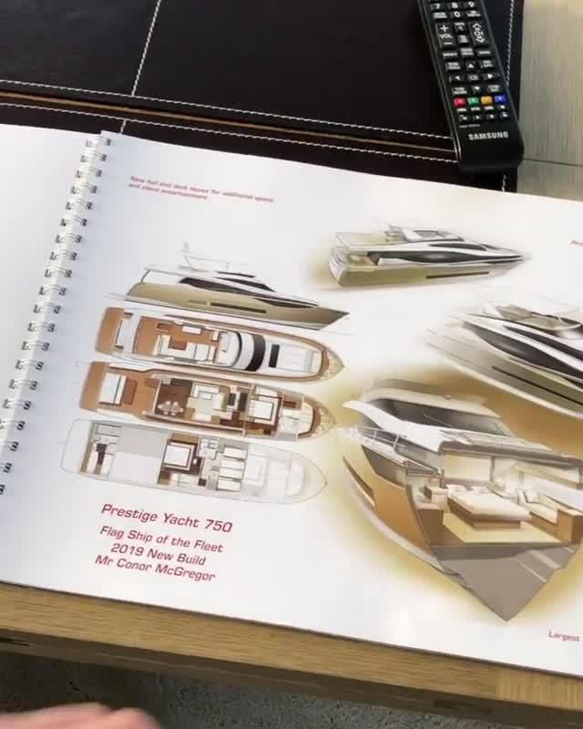 Conor McGregor flicks through the brochure for his new yacht