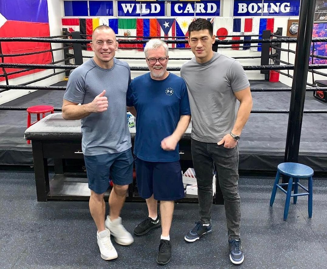 St Pierre trains in Roach's Wildcard Boxing gym and is pictured alongside his trainer and boxer Dmitry Bivol
