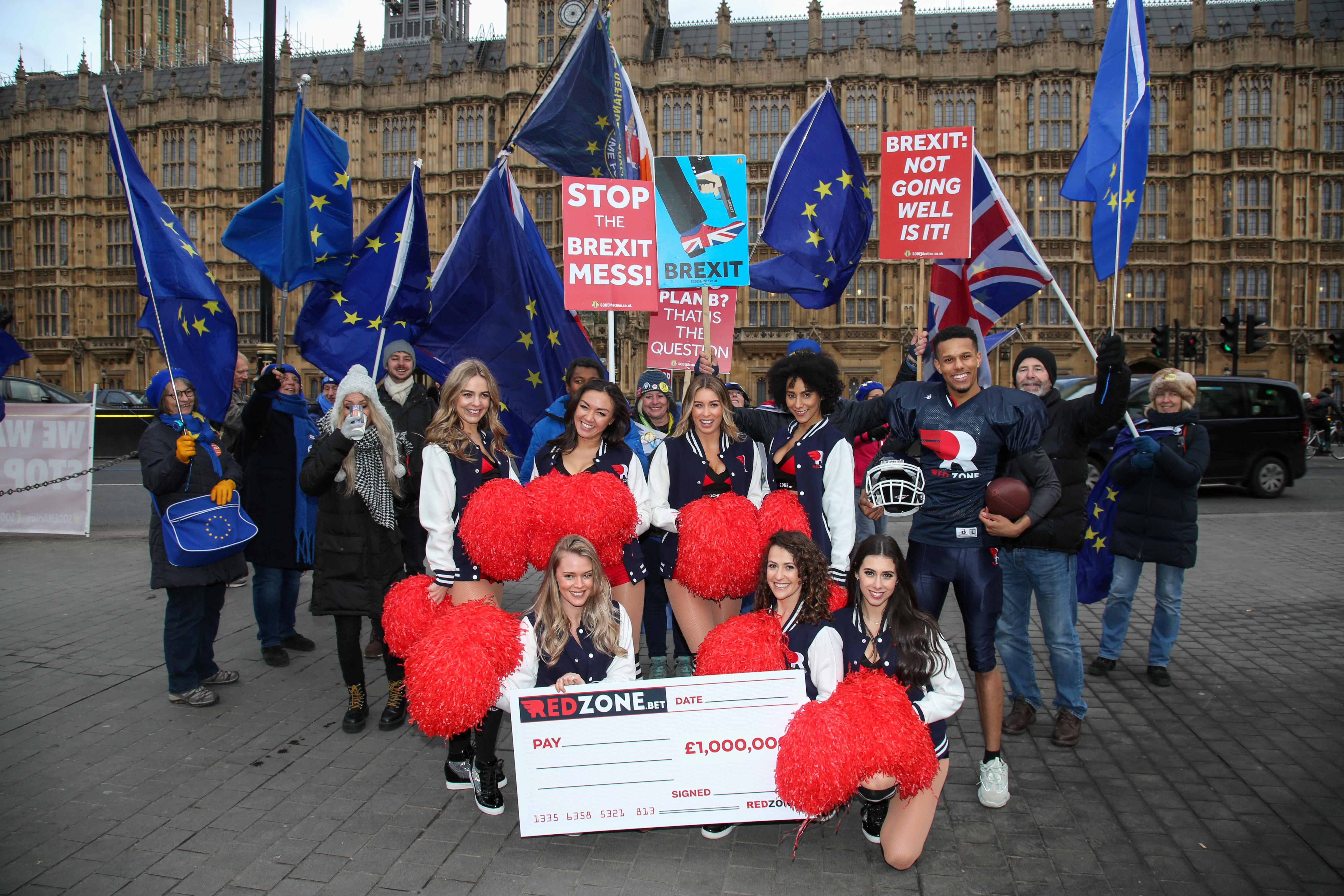 Cheerleaders interrupt an anti-Brexit campaign while performing in London