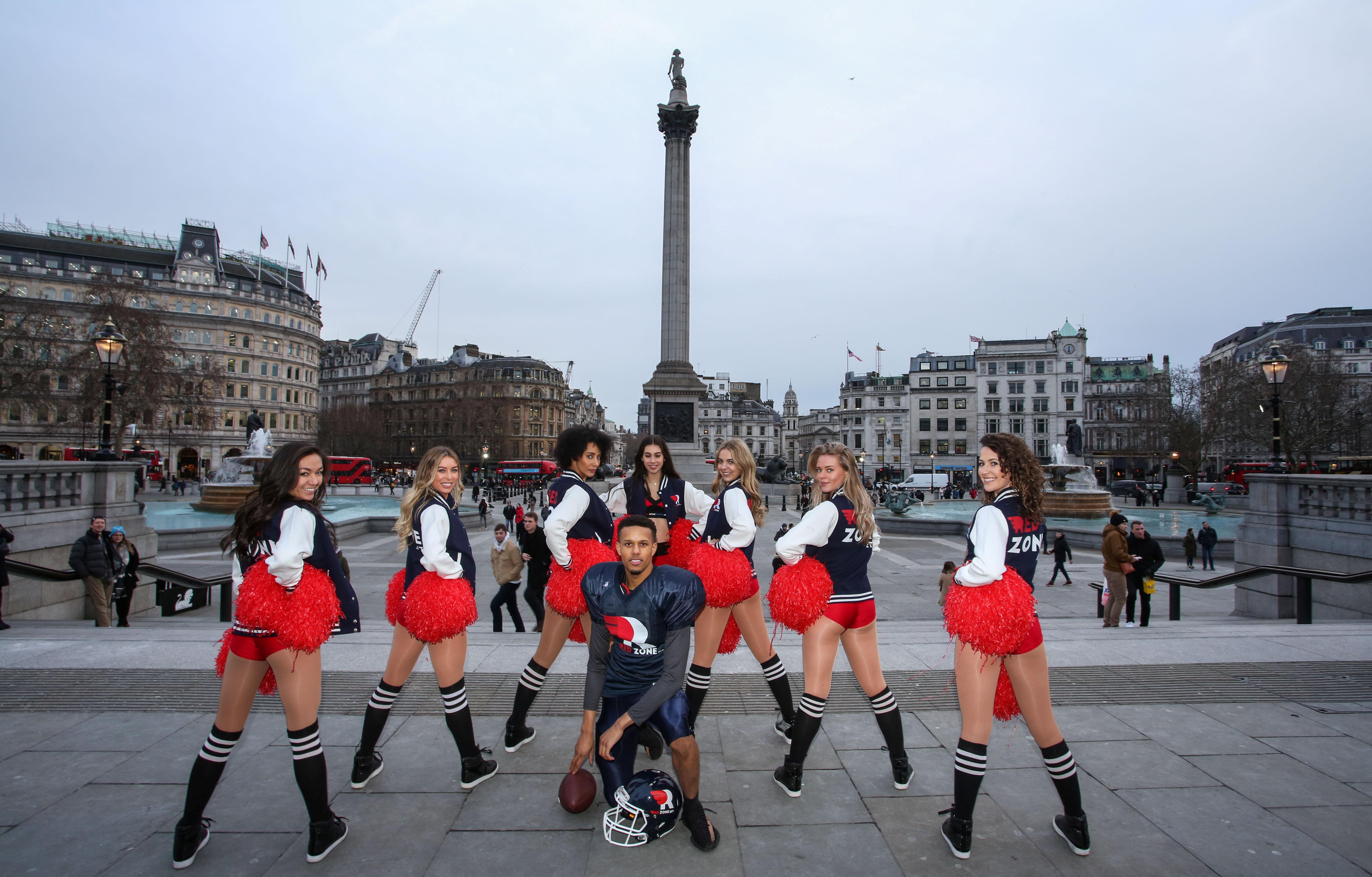Cheerleaders hit London's tourist attractions on Friday