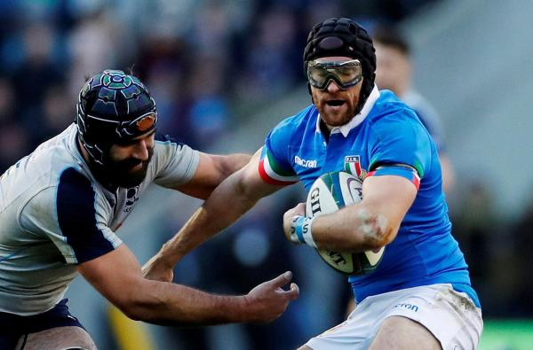 Who is Ian McKinley, and why does Italy rugby ace wear goggles?